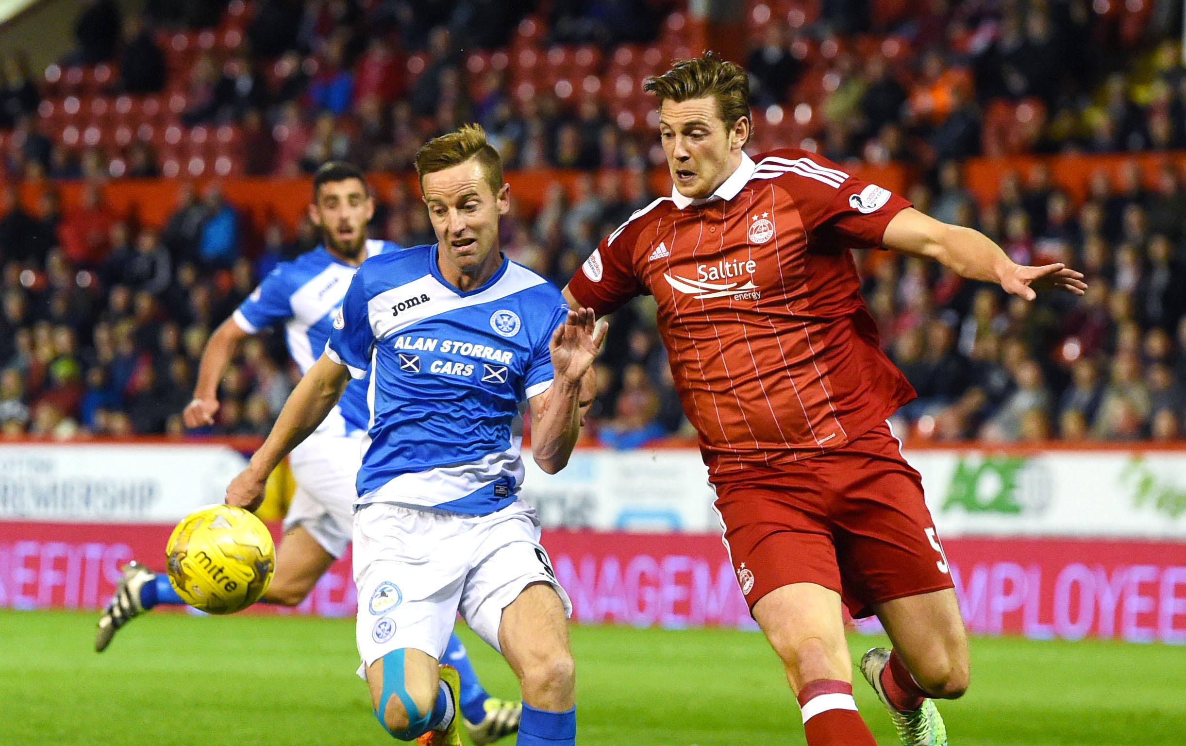St Johnstone's Steven MacLean battles with Ash Taylor.