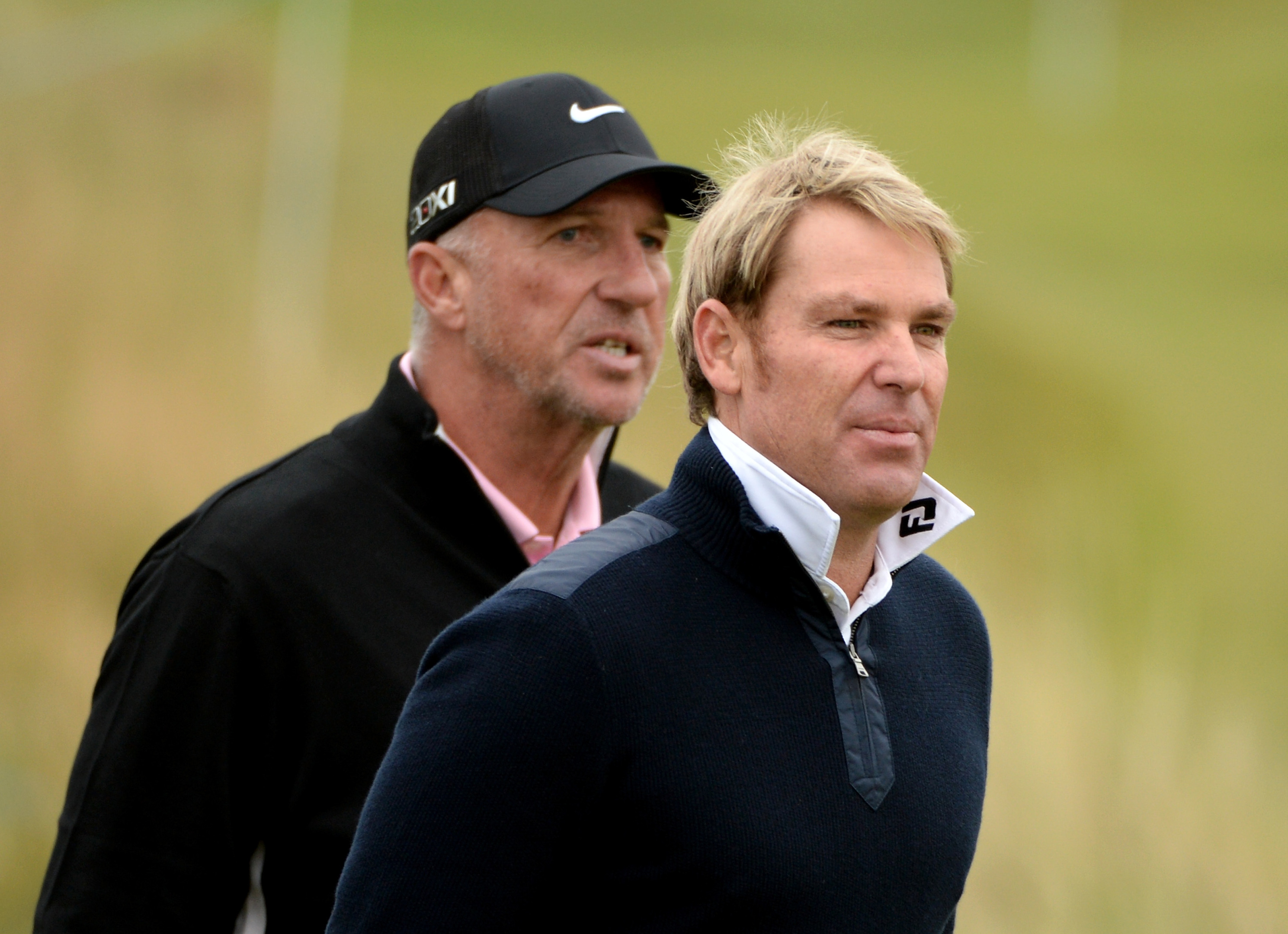 Shane Warne and Sir Ian Botham at Kingsbarns during a practice round of the Alfred Dunhill Links Championship in 2013