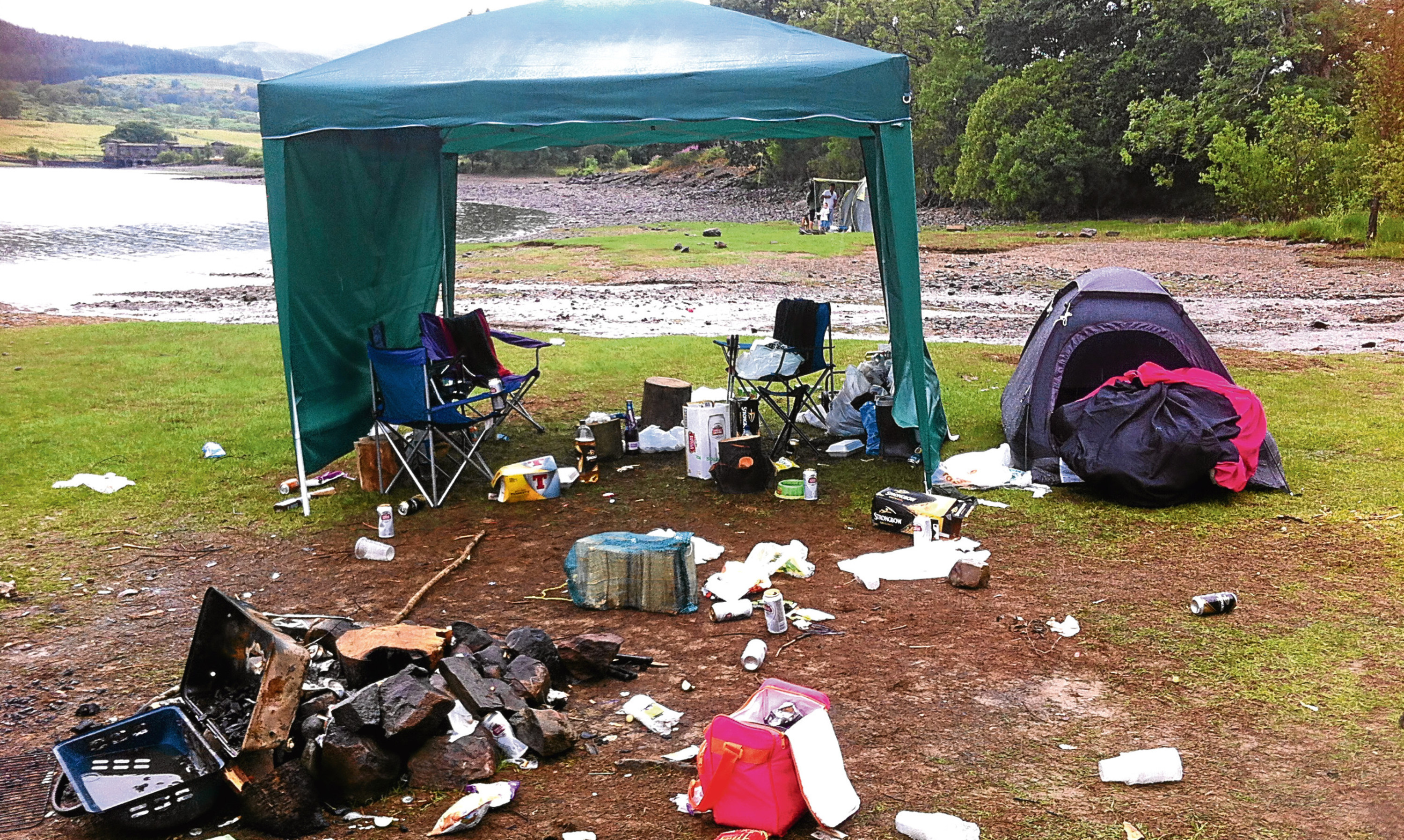 Mess left on a Scottish lochside by inconsiderate campers.