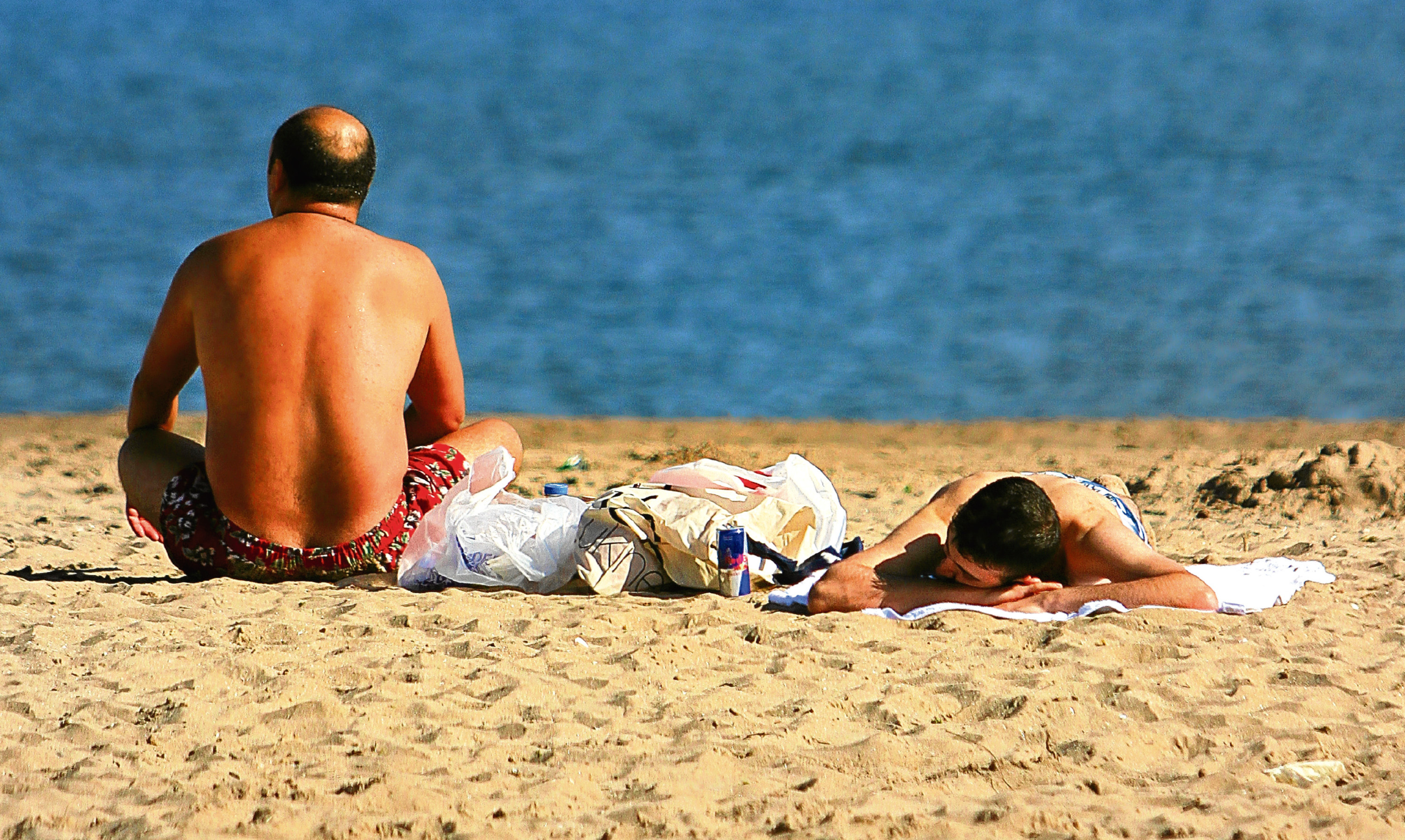 Sunbathers at Broughty Ferry beach make the most of what is often a very limited Scottish summer.