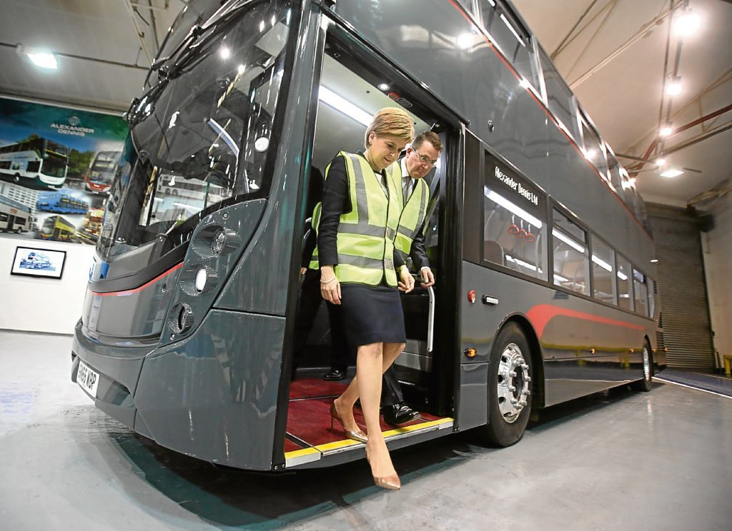 First Minister Nicola Sturgeon with Colin Robertson, Chief Executive of Alexander Dennis Limited during a visit to Alexander Dennis Limited as more than 100 jobs are to be created at the Falkirk bus maker with the support of Scotland's biggest-ever research and development grant. PRESS ASSOCIATION Photo. Picture date: Monday September 5, 2016. The firm is to receive £7.3 million from Scottish Enterprise towards its £31 million low carbon vehicles programme. See PA story SCOTLAND Jobs. Photo credit should read: Andrew Milligan/PA Wire