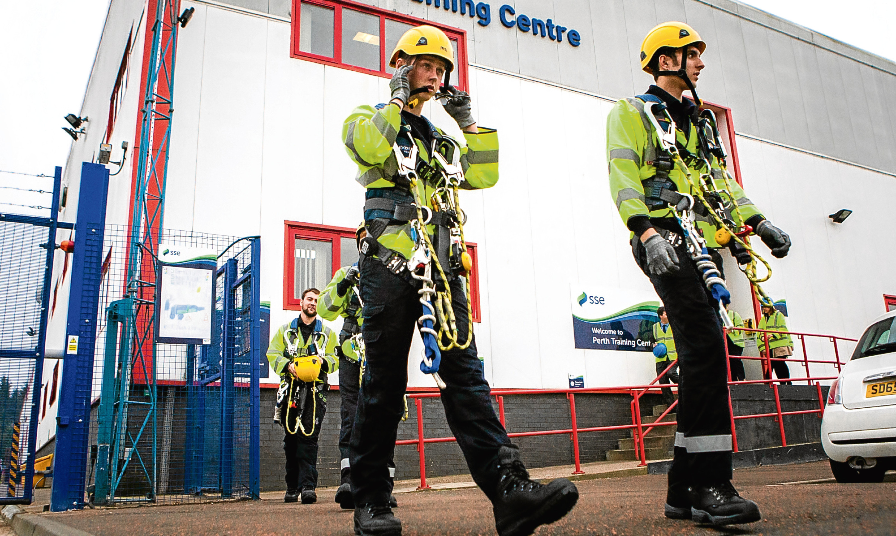 SSE trainees in their high visibility safety wear and climbing gear.