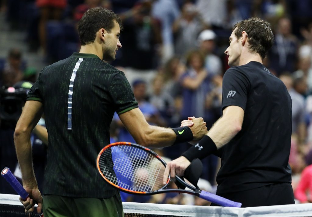 Andy Murray shakes hands with Grigor Dimitrov.