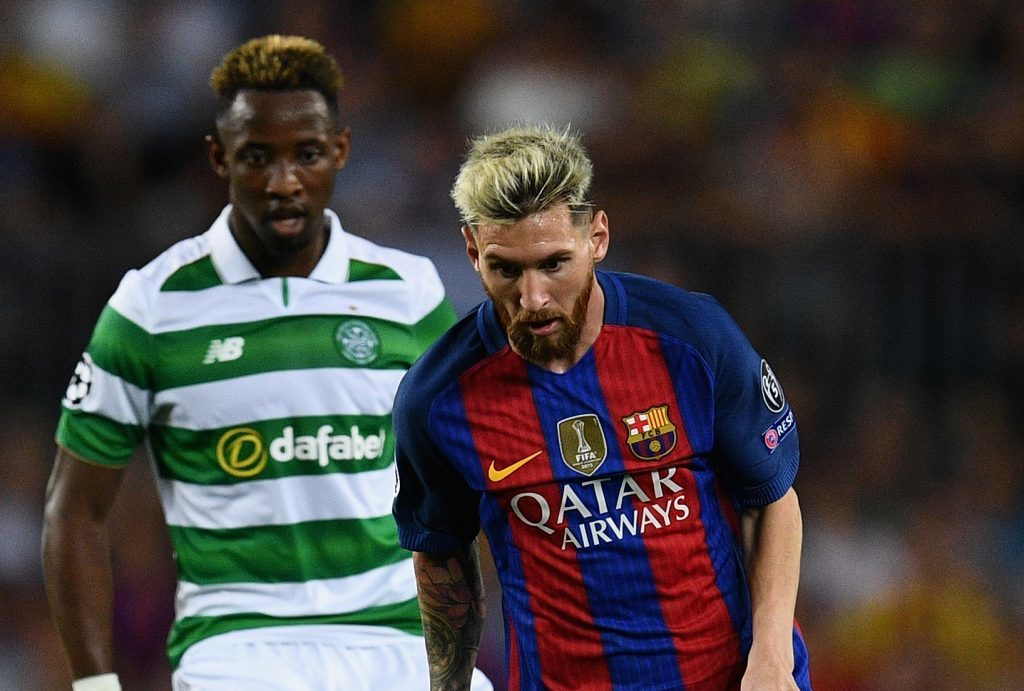 Moussa Dembele watches Lionel Messi work his magic.
