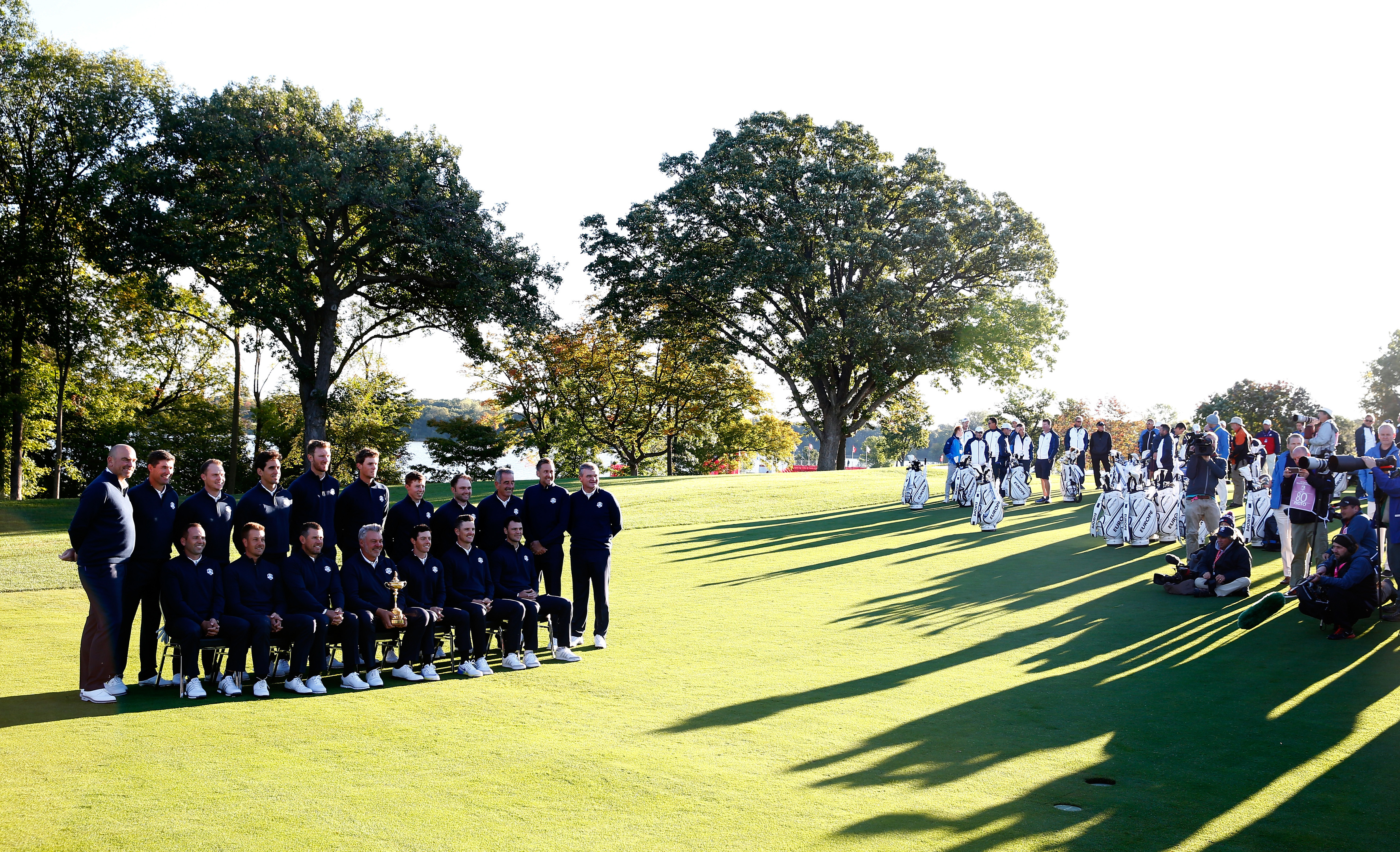 Darren Clarke and his European team satnd (and sit) shoulder to shoulder at Hazeltine yesterday.