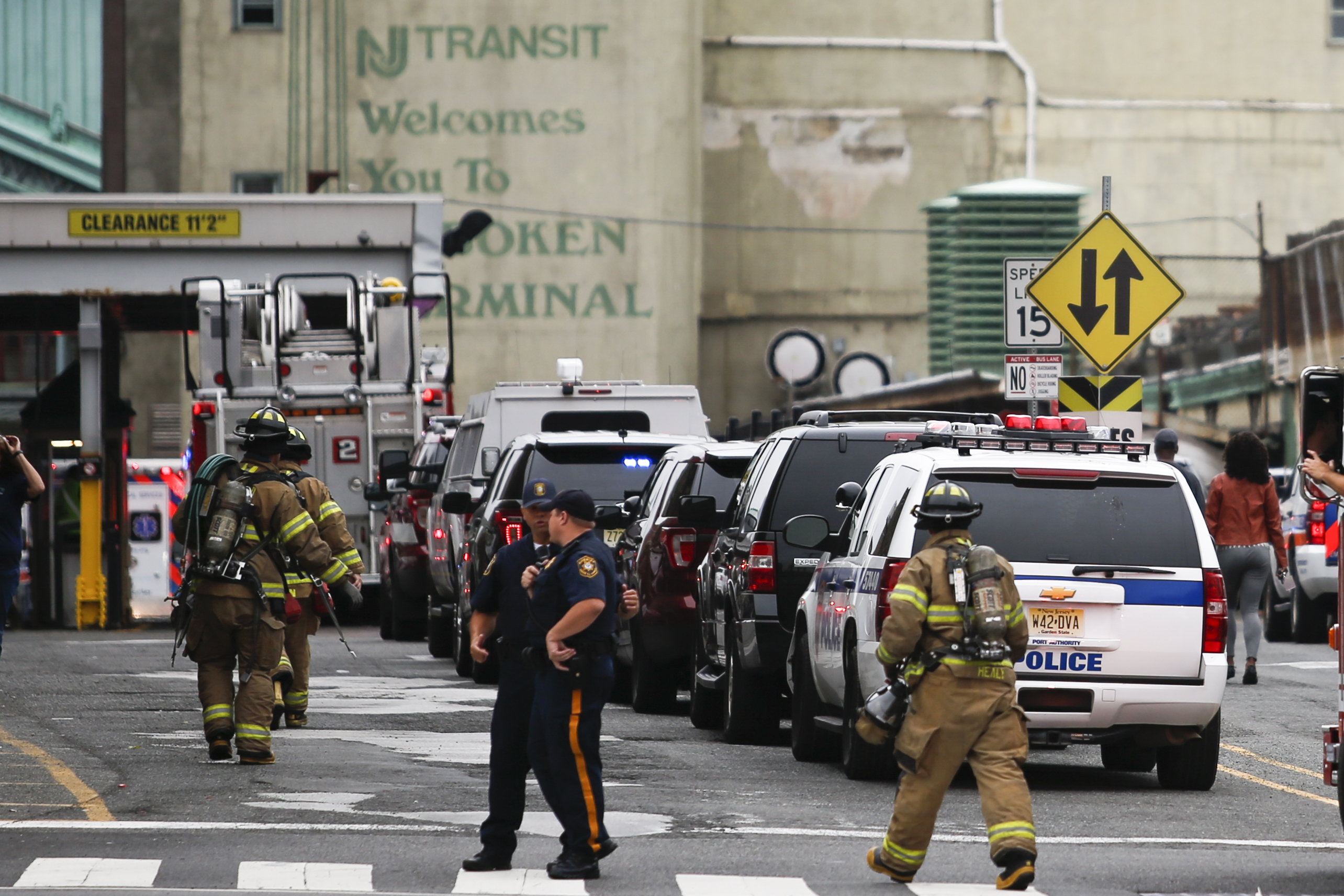 Police officers and firefighters arrive to the train terminal after a New Jersey Transit train crashed into the platform at Hoboken Terminal during morning rush hour