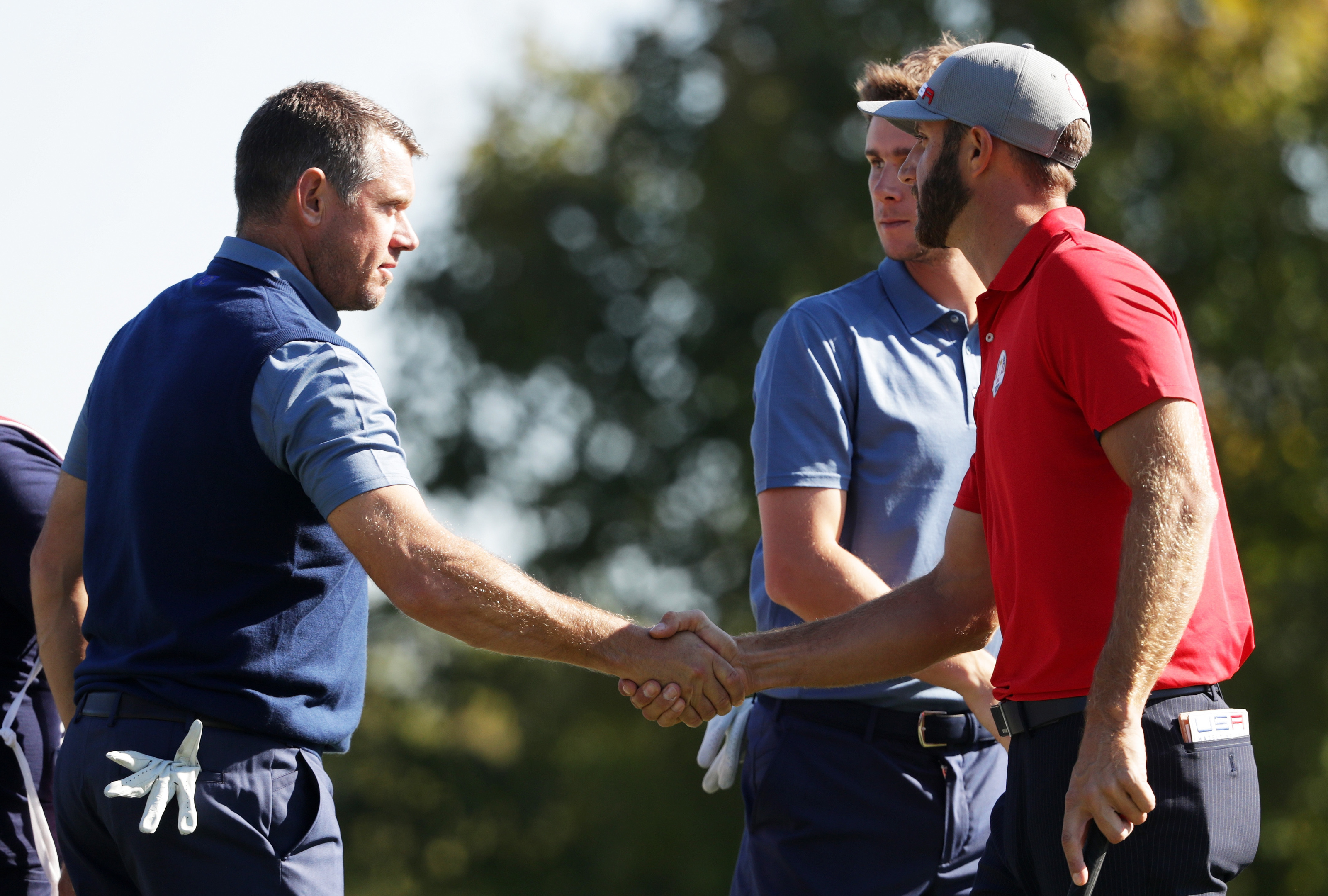 Lee Westwood congratulates Dustin Johnson at the end of their foursomes match at Hazeltine.