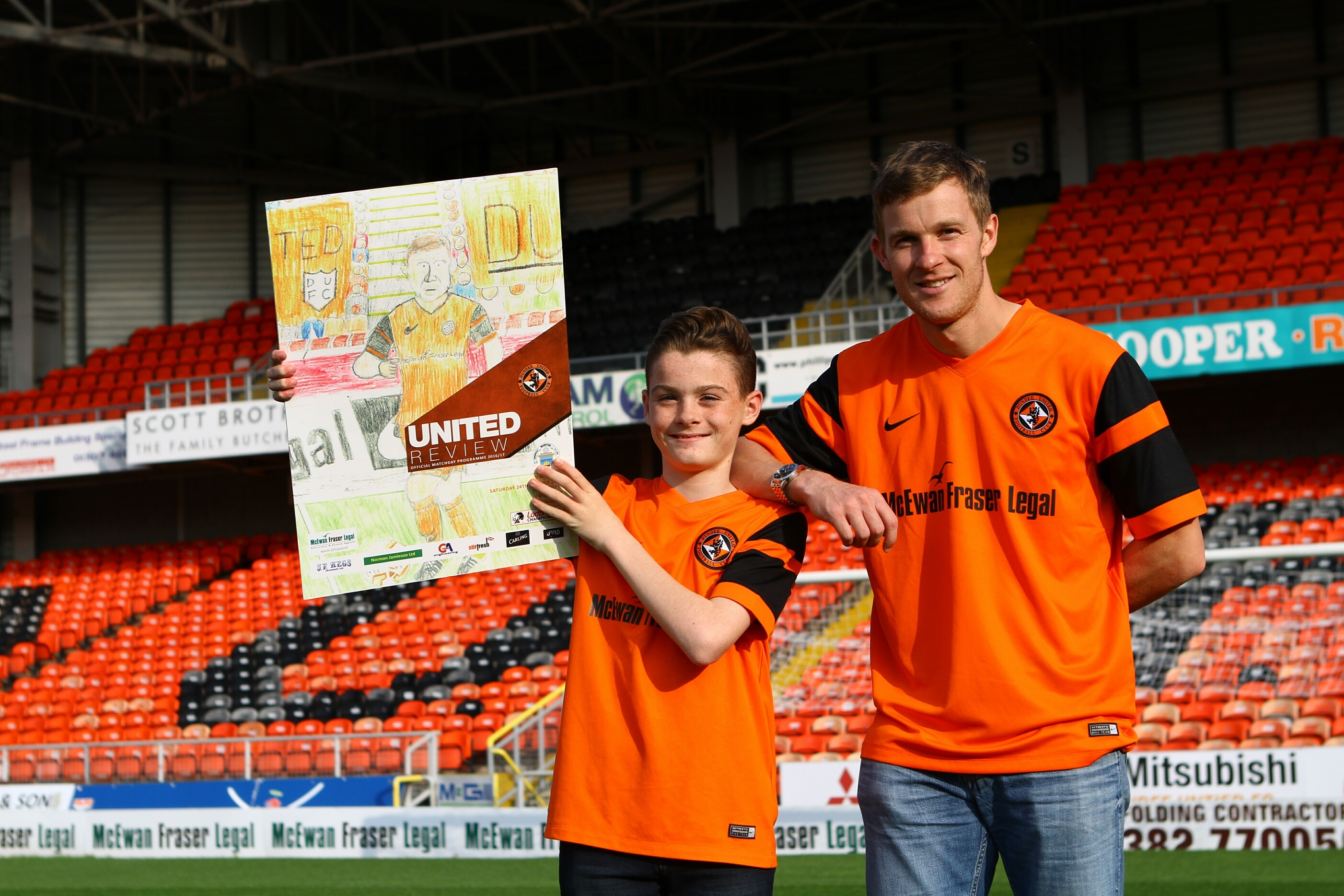 Aiden Hutton and Paul Dixon show off Aiden's cover at Tannadice.