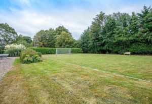 The former tannadice man's lawn is big enough for a football pitch