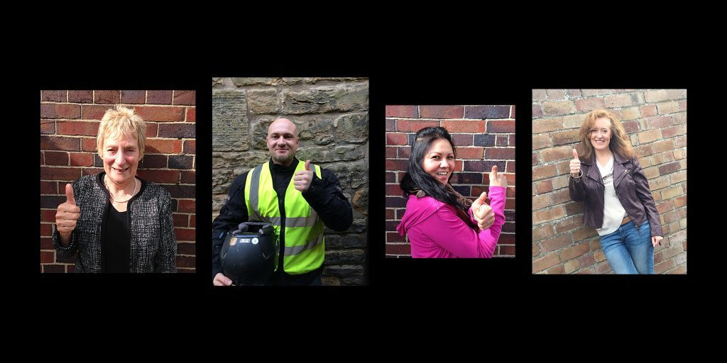 Volunteers in St Andrews lending their support to the 'thumbs-up' campaign