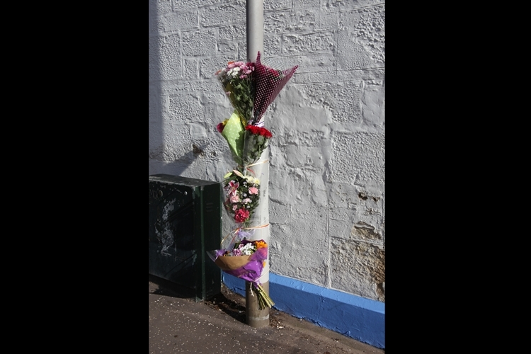Floral tributes for Mrs Stormont at Keptie Street.