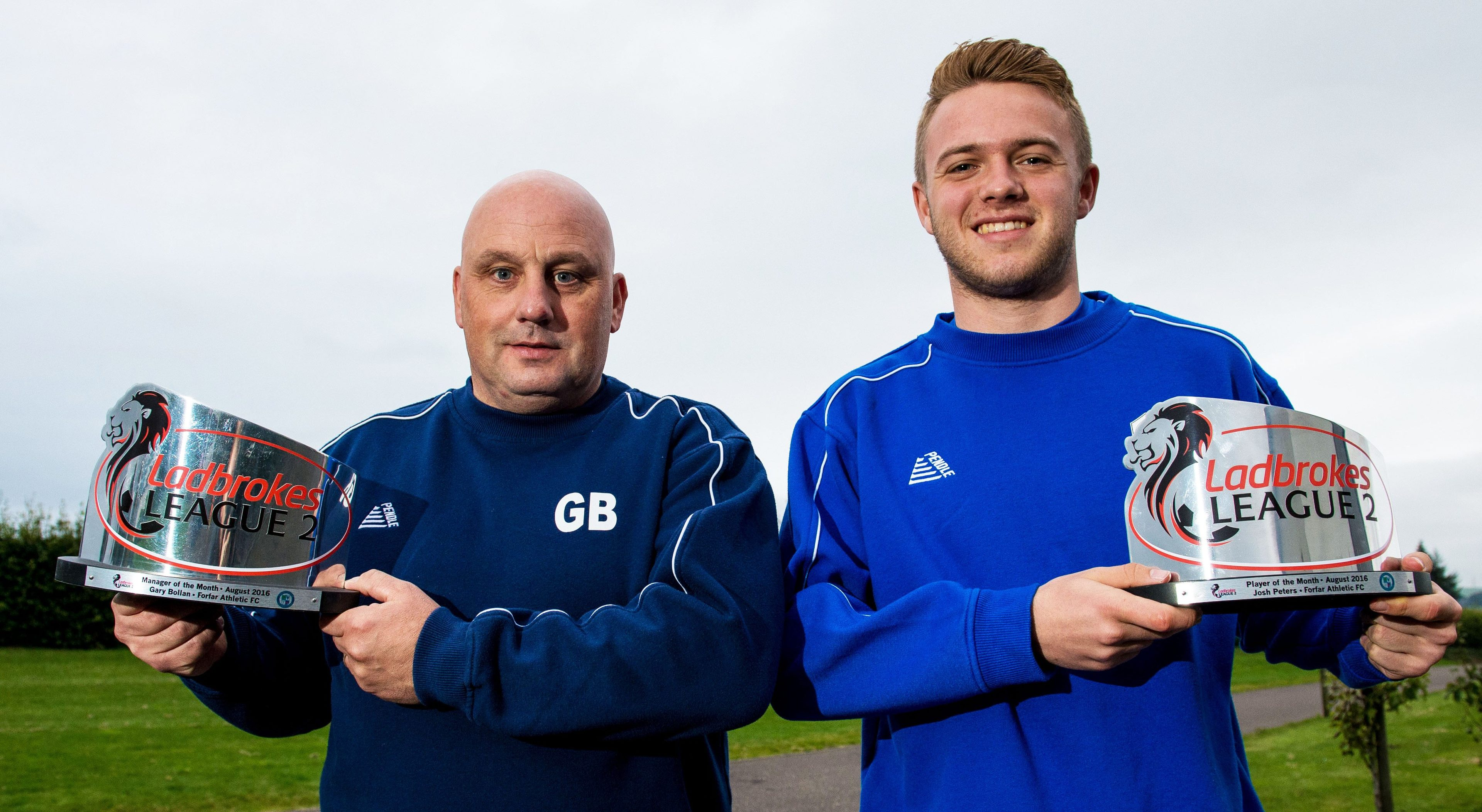 Gary Bolllan and Josh Peters with their awards.