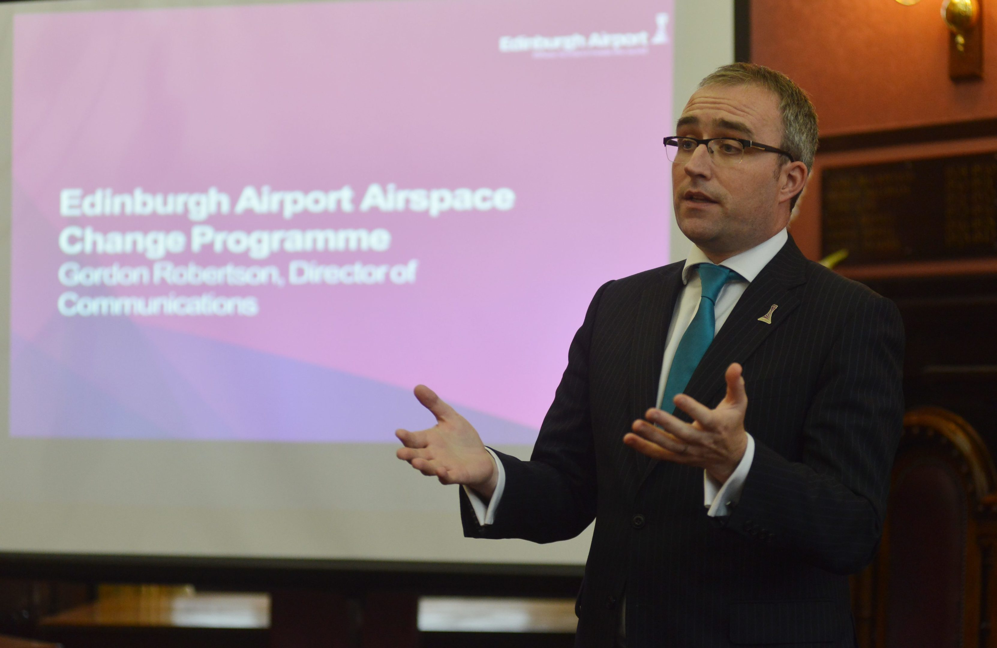 Edinburgh Airport director of communications Gordon Robertson consulting public over changes to flight paths at Dunfermline City Chambers.