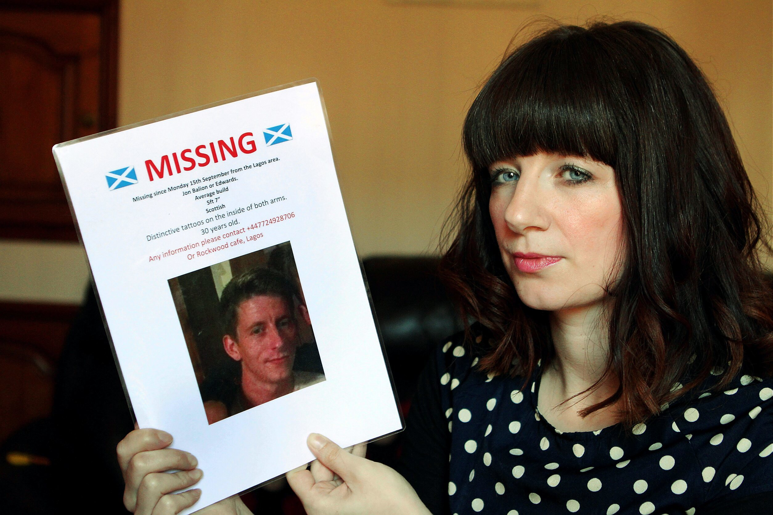 Kenna Balion with a Missing poster of her brother Jon