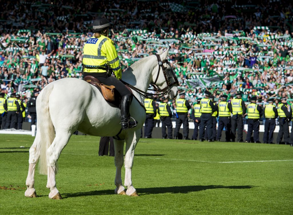 Police line the pitch to push back the Hibernian fans