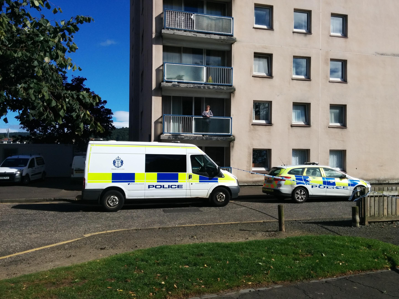 Police at the Pomarium flats.
