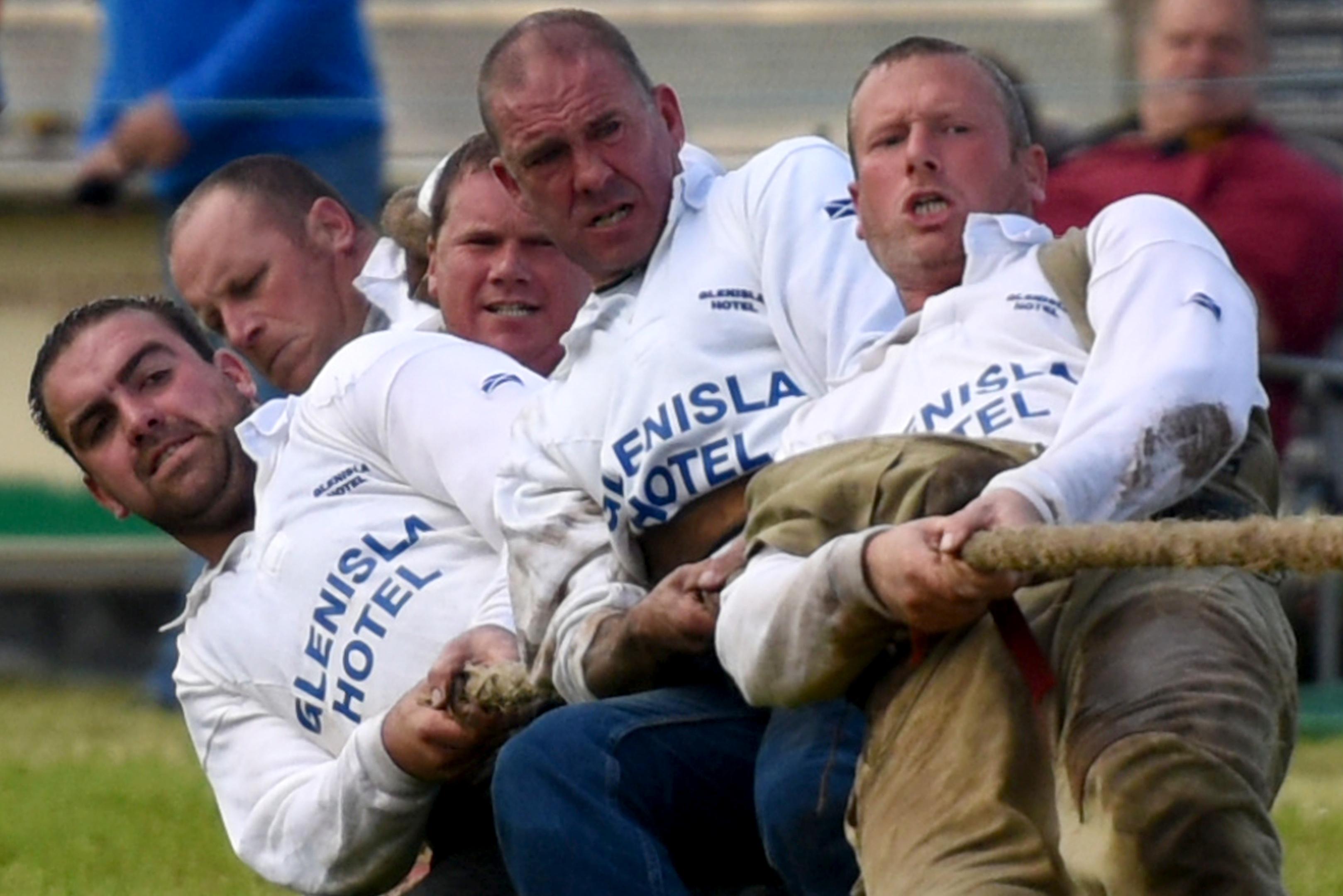 The Glenisla Hotel tug-o-war team in action.