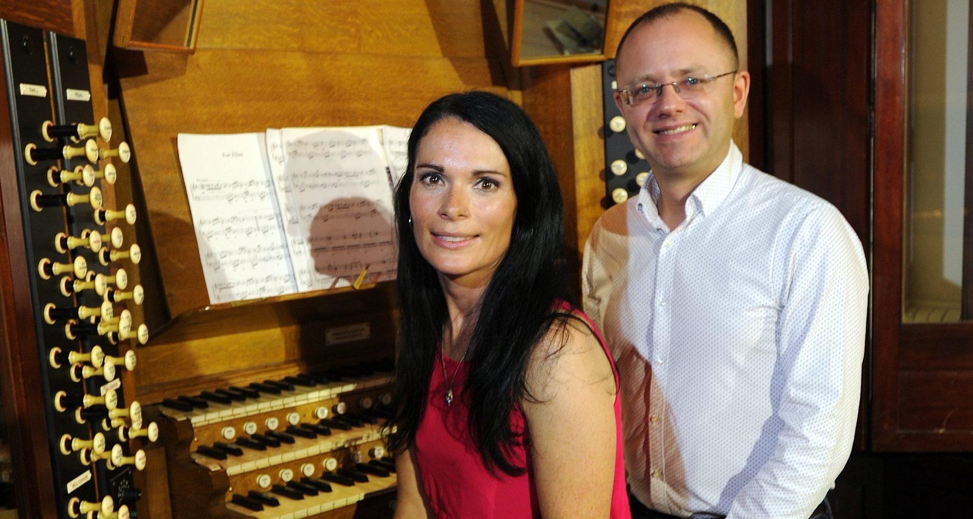 Gayle Ritchie and City Organist Stuart Muir sitting at the Caird Hall organ.