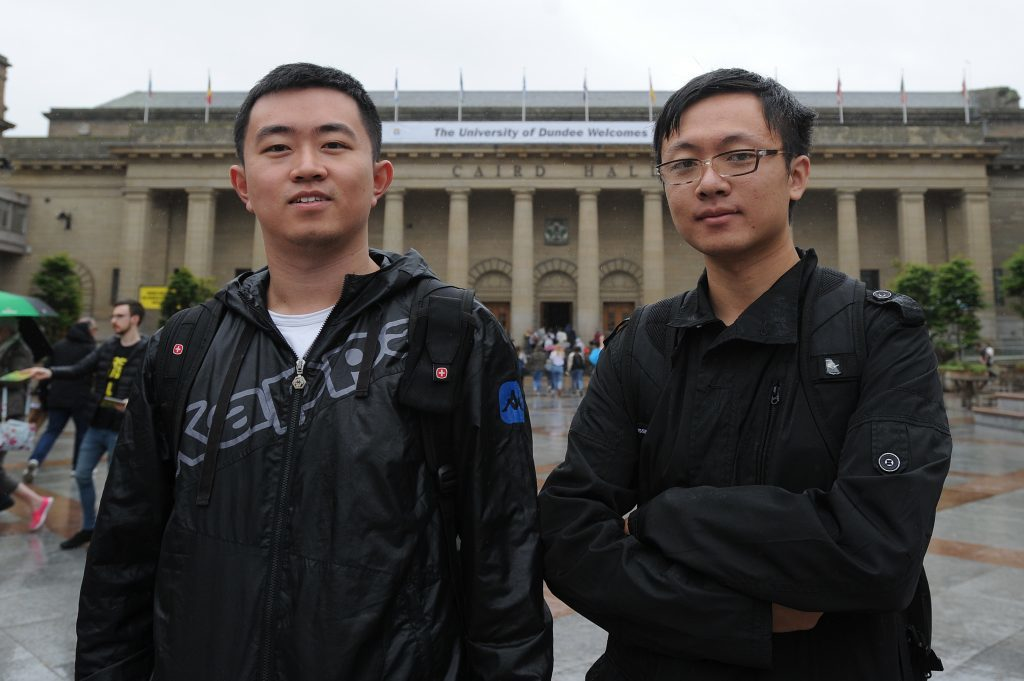 Courier News - Dundee - Dundee story - the University of Dundee gave a welcome in the Caird Hall to fresher students arriving to study in the city for the first time. Picture Shows; l to r - Wei Lee and Yany Xu, City Square, Dundee, Monday 05 September 2016