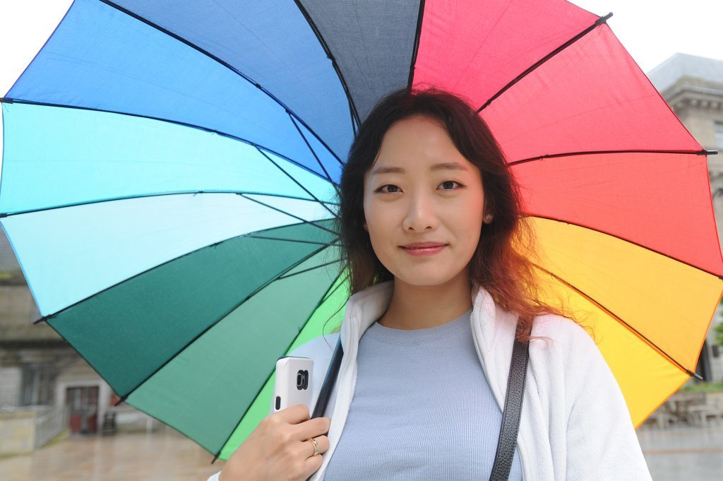 Courier News - Dundee - Dundee story - the University of Dundee gave a welcome in the Caird Hall to fresher students arriving to study in the city for the first time. Picture Shows; Ulrim Yang who added a splash of colour, City Square, Dundee, Monday 05 September 2016