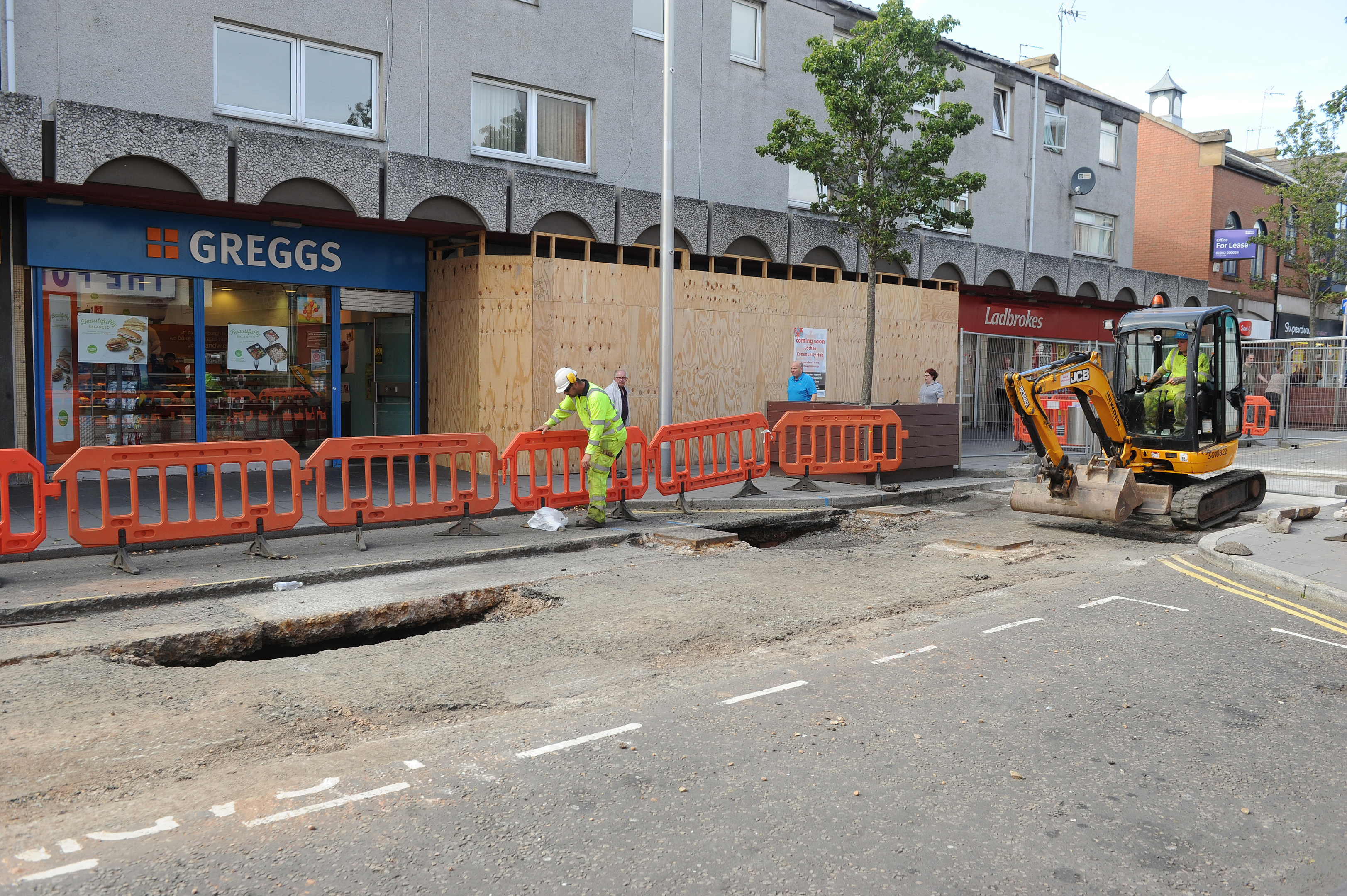 Contractors at work on Lochee High Street.