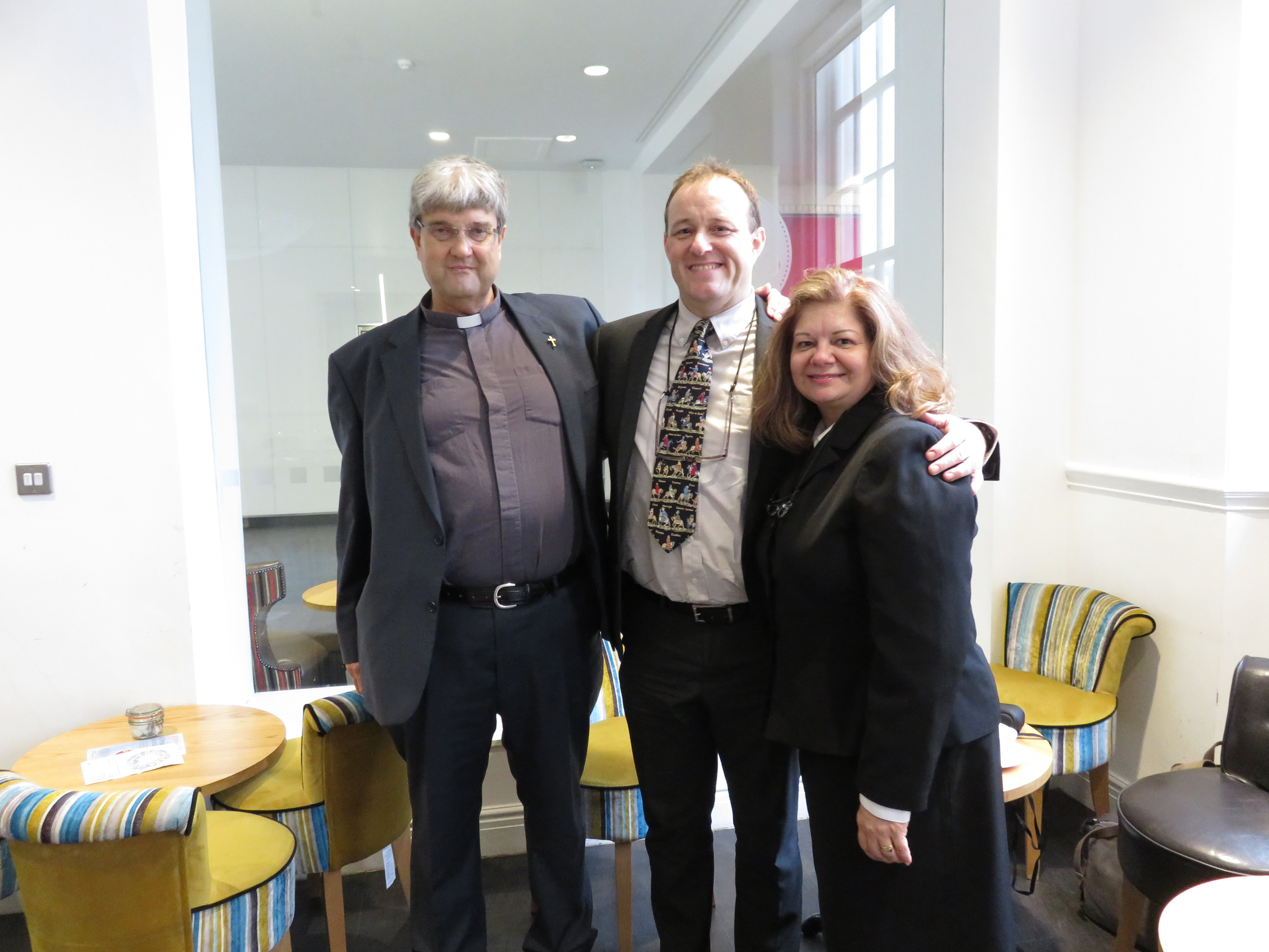 Celebrations: Karen and Bruce Officer with Reverend Roy Stagg, who married the couple