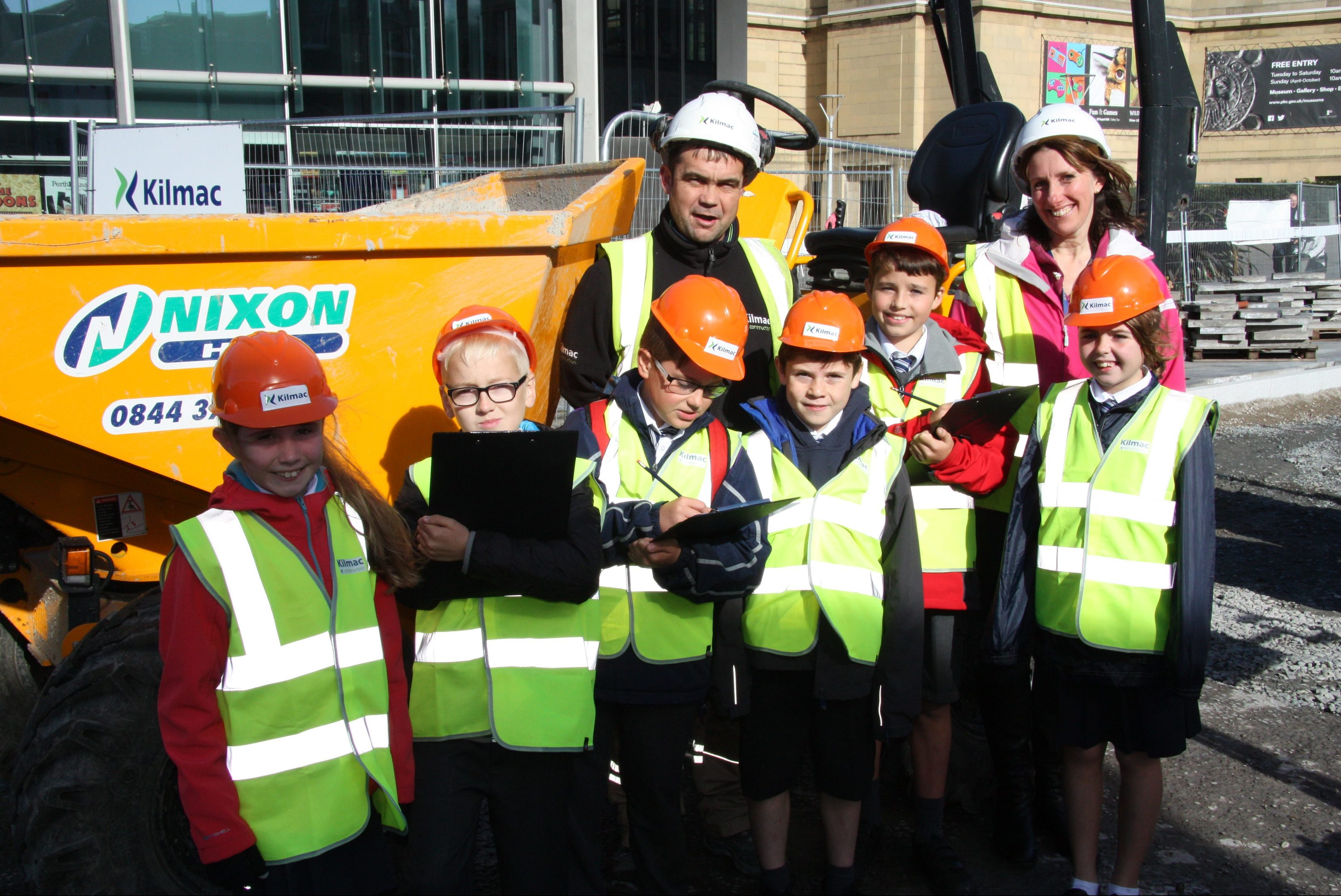 Teacher Fiona Gellatly with some of her Viewlands Primary P6 class who were given a Mill Street site tour by Kilmac foreman Derek Riddoch.