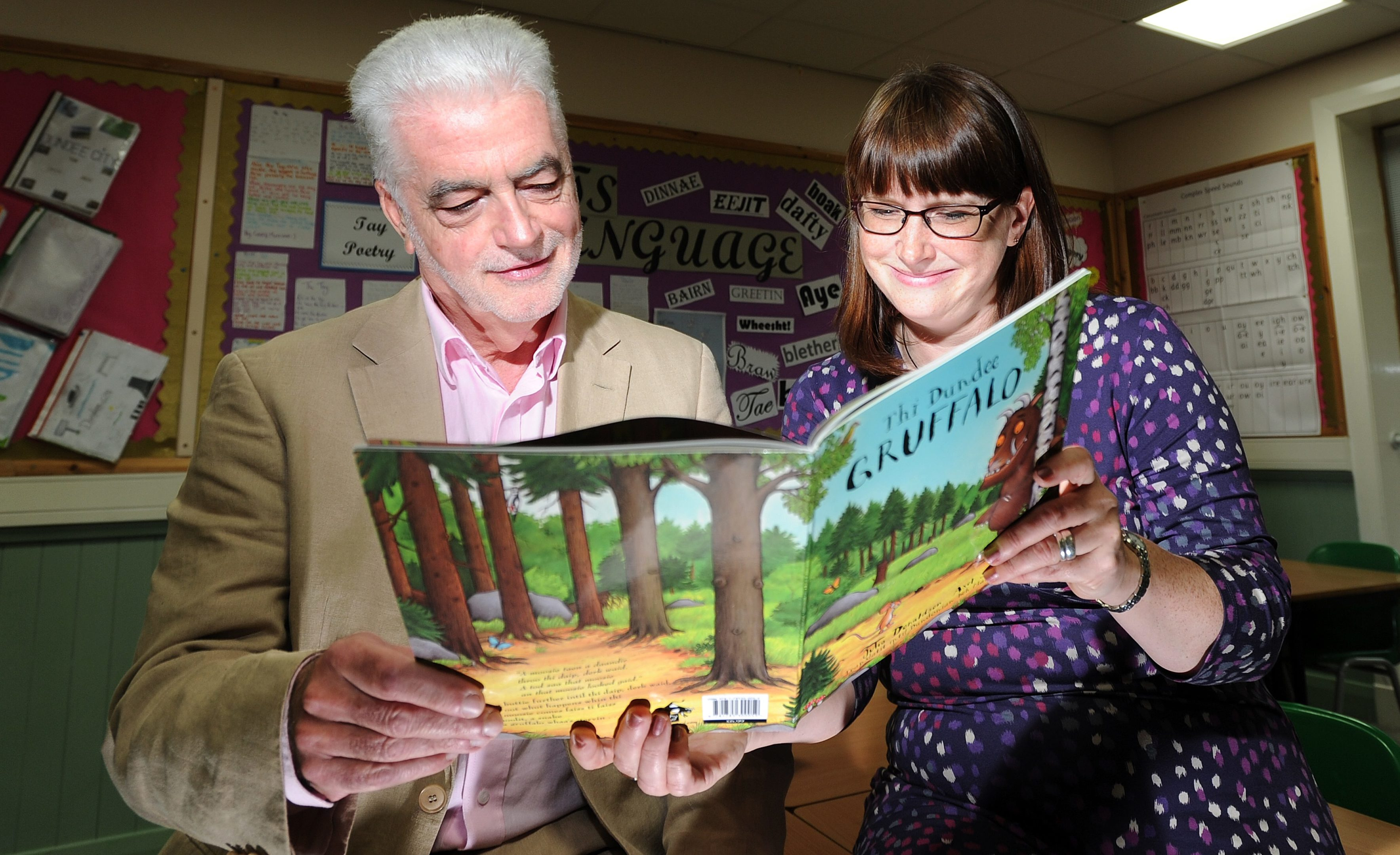Billy Kay and Diane Anderson peruse the Dundee Gruffalo at Morgan Academy in 2016
