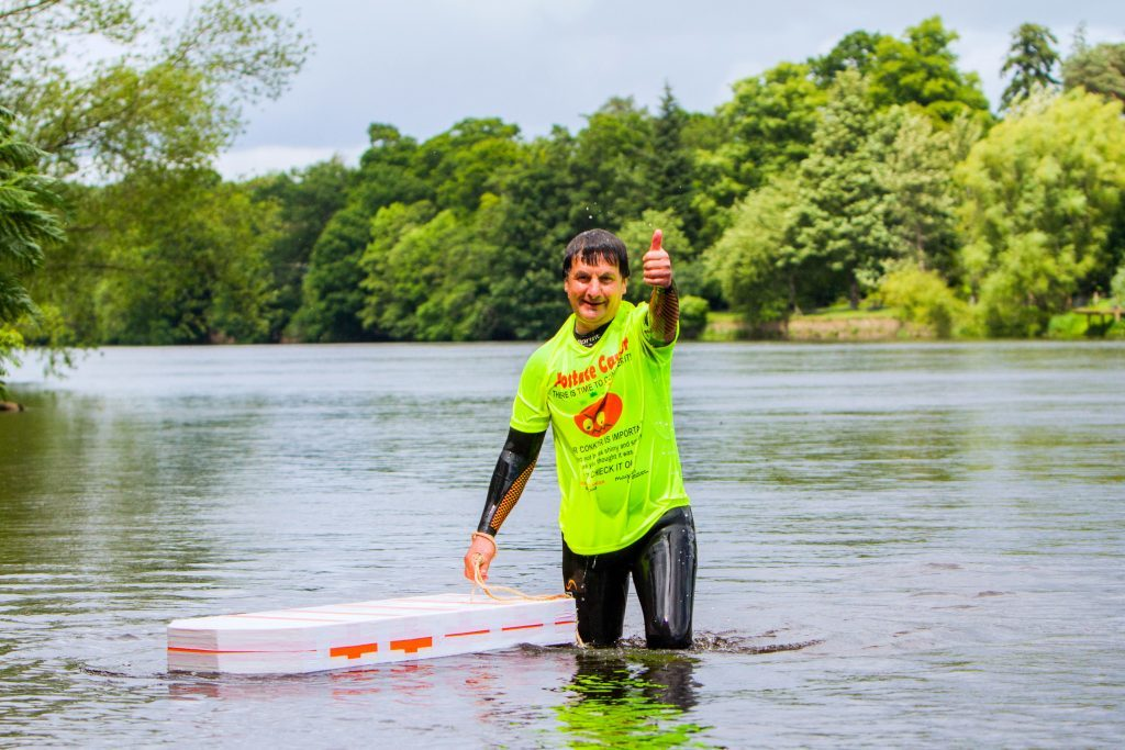 Sam Morshead swimming in River Tay to publicise charity fundraiser for prostate cancer.