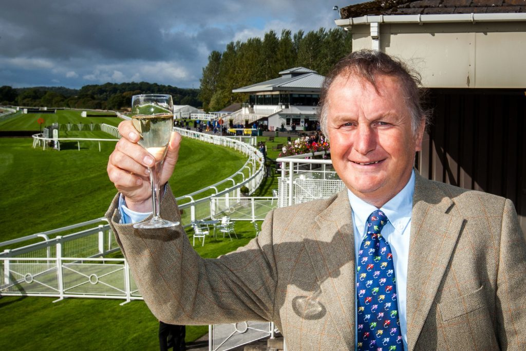 Sam Morshead raises a glass on his last race day as general manager of Perth Racecourse