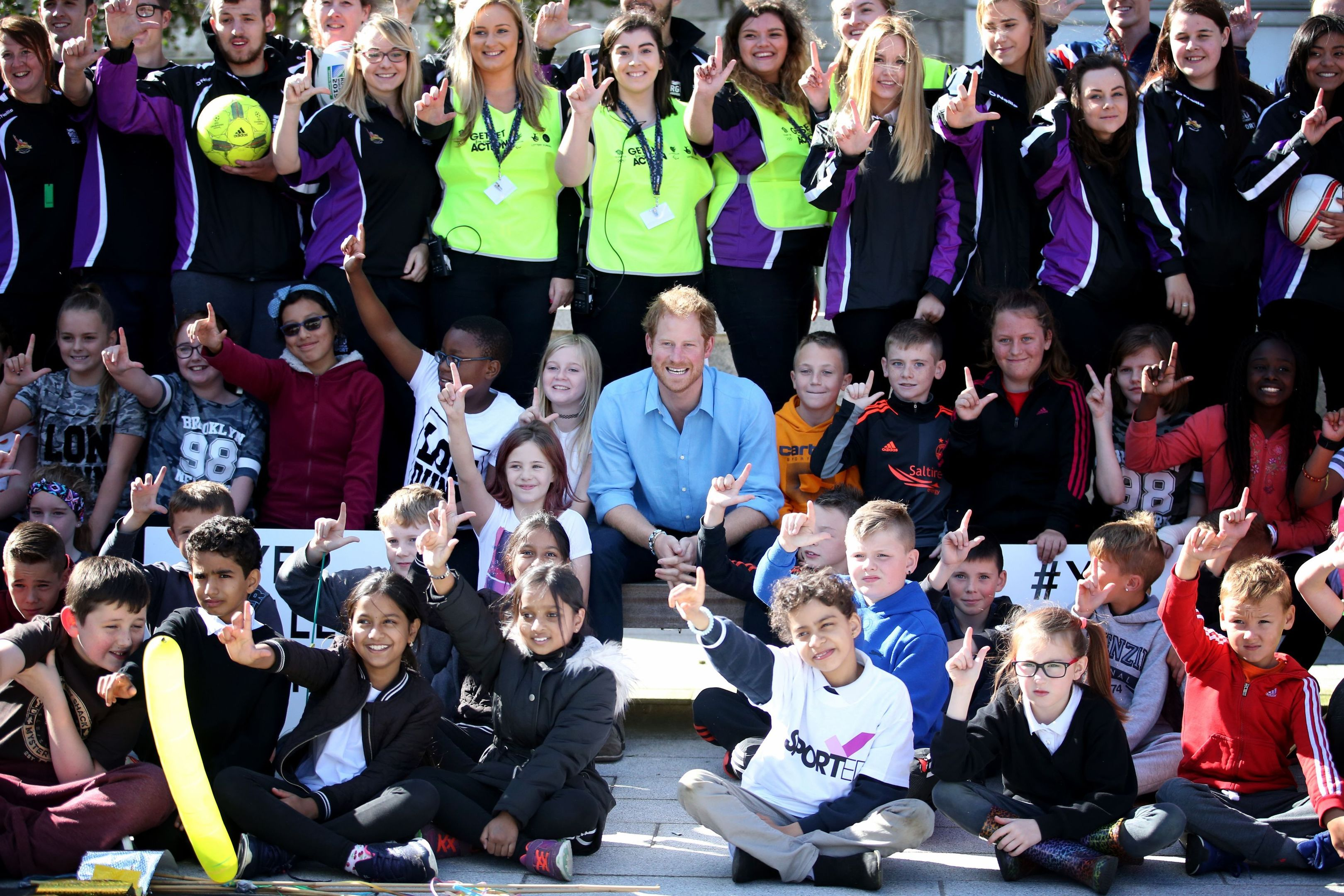 Prince Harry with volunteers from the Streetsport charity and pupils from Kaimhill School during a visit to Robert Gordon University in Aberdeen