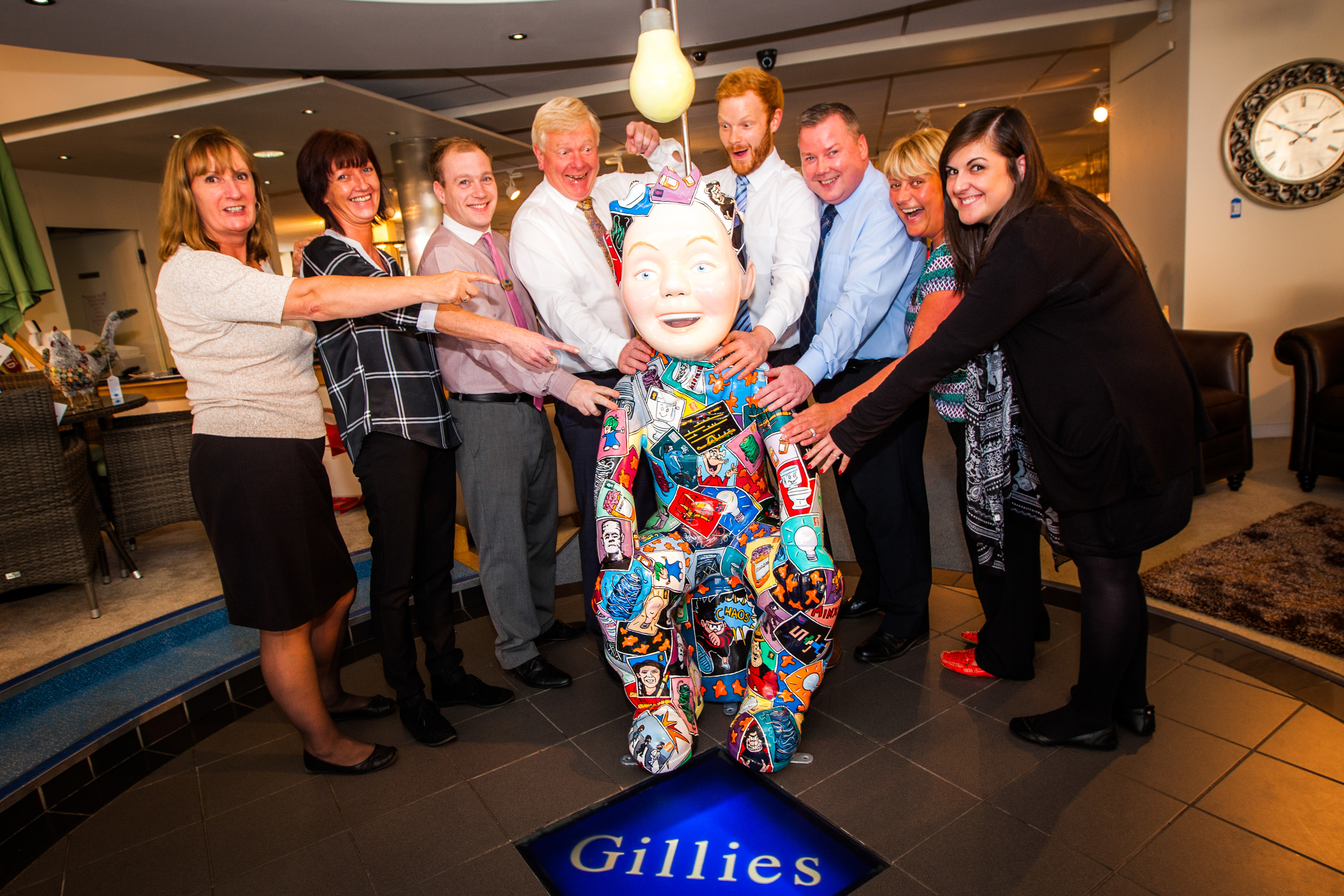 Staff at Gillies of Broughty Ferry with their new addition.