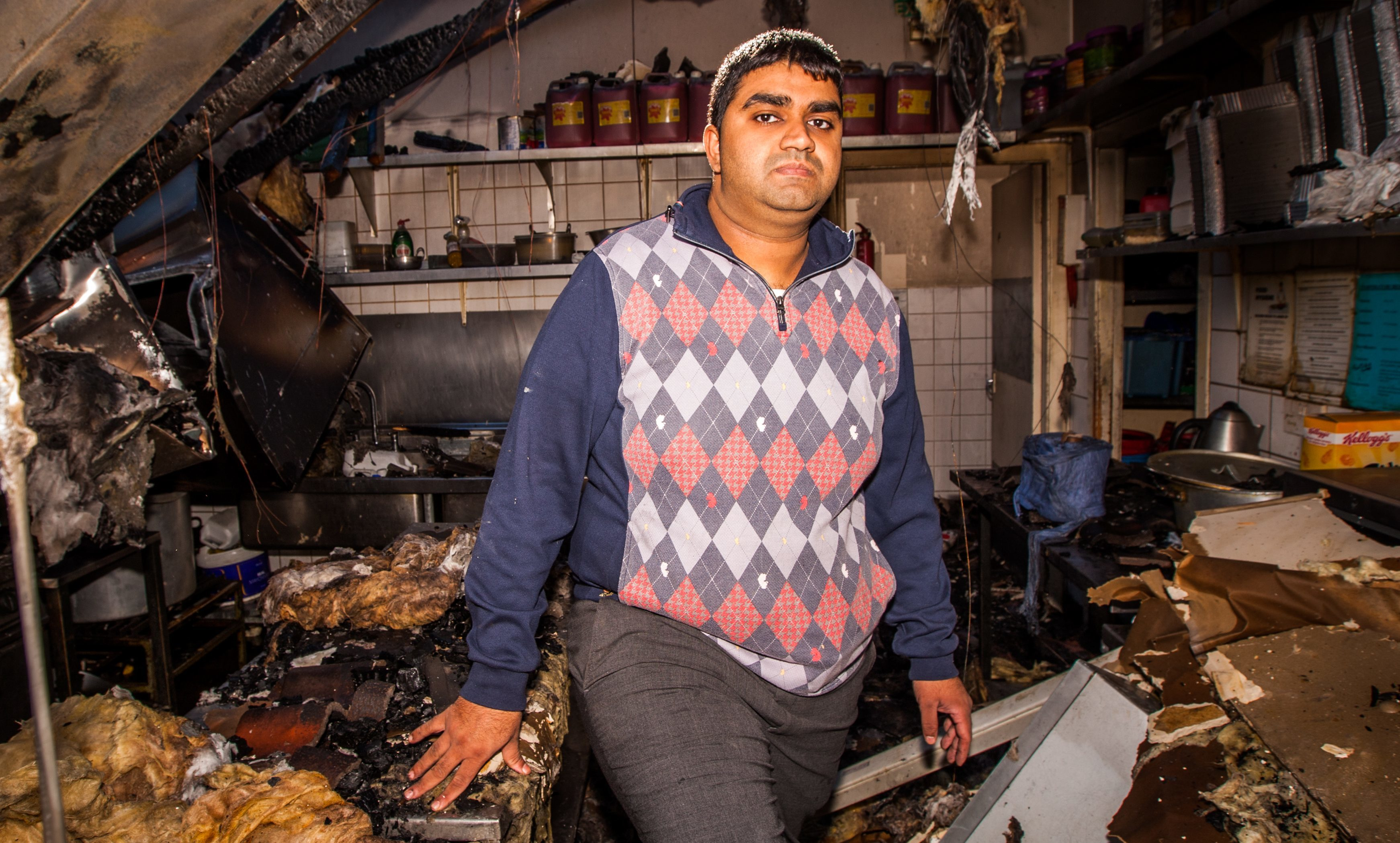 Imran Mohammed in the aftermath of September's fire. He remains committed to seeing Cafe Aladin's return to the western edge.