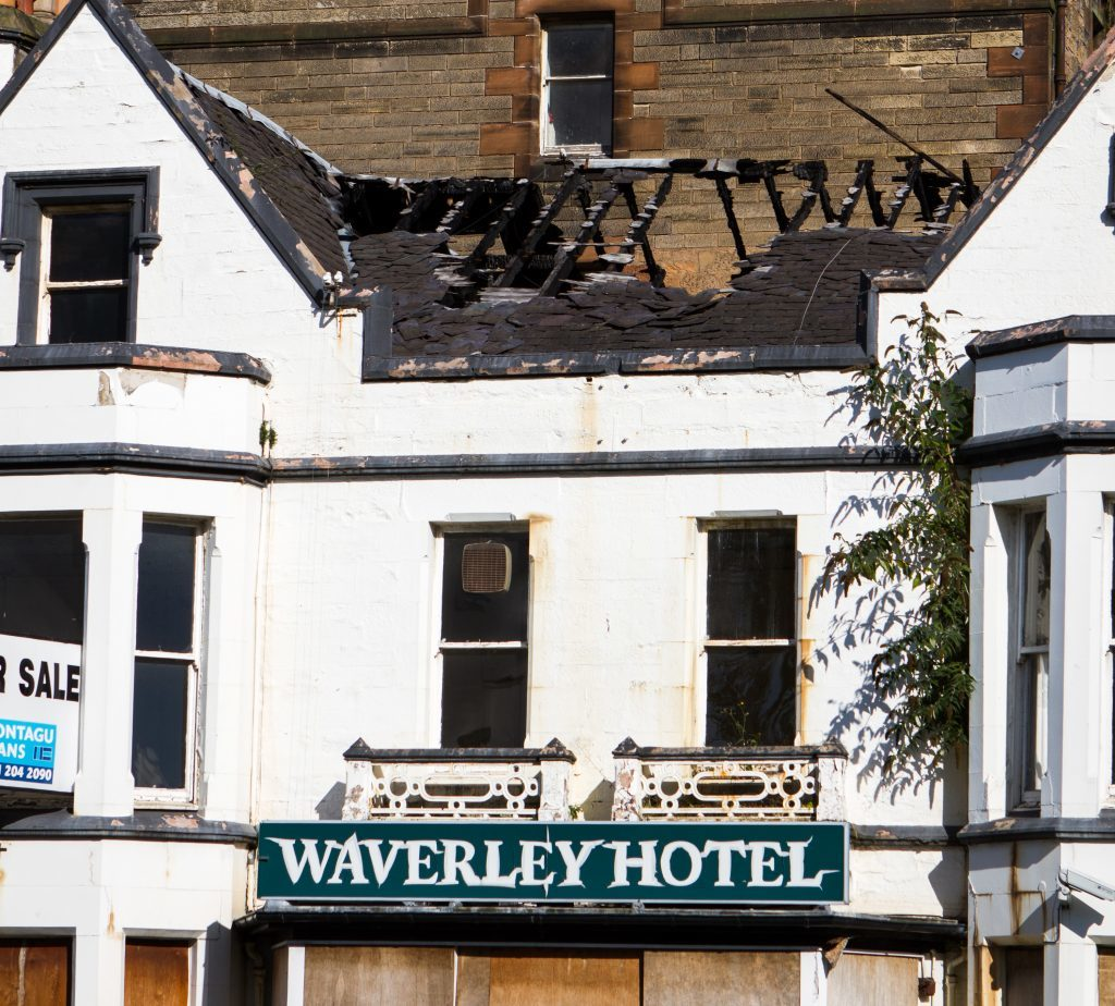 Charred roof timbers are visible at the Waverley Hotel.