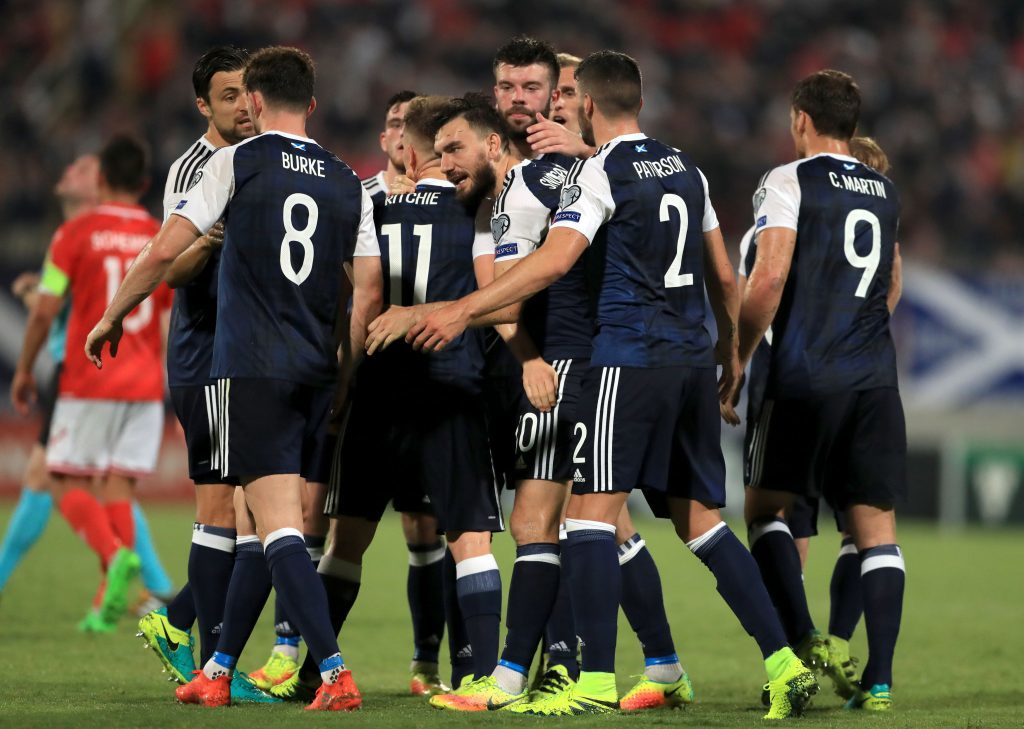 Scotland's Robert Snodgrass celebrates scoring his side's third goal of the game from the penalty spot with teammates during the 2018 FIFA World Cup Qualifying match at the Ta'Qali National Stadium, Malta.
