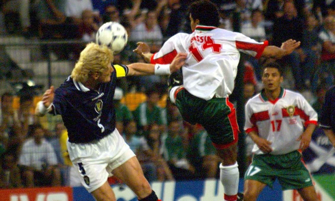 Ex-Scotland captain Colin Hendry clears the ball from Salaheddine Bassir of Morocco at the France 98 World Cup.