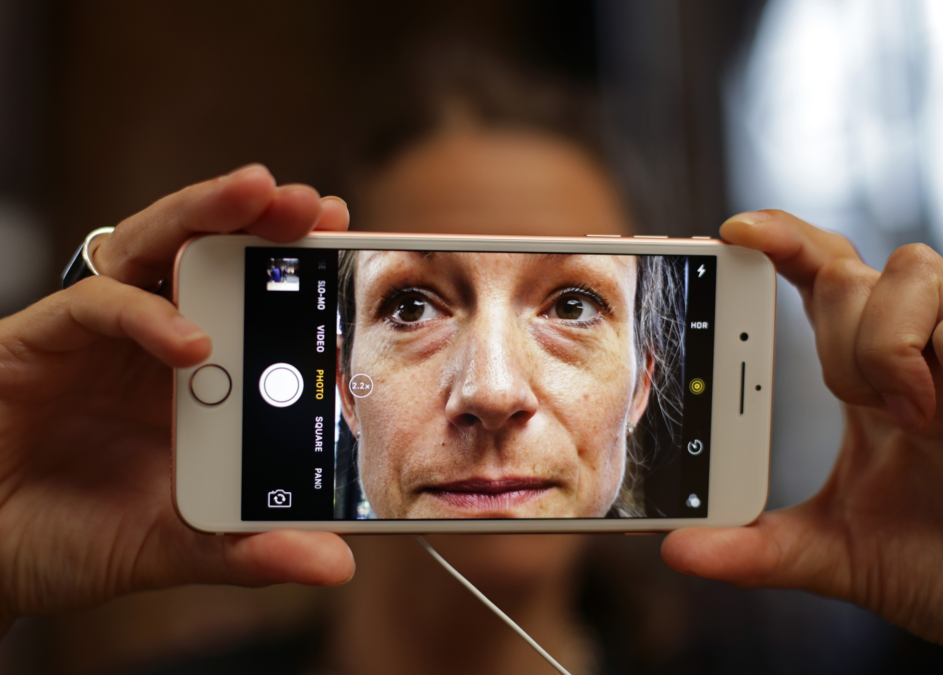 Kathrin Milic tests the camera on an iPhone 7 in the Apple Store in Covent Garden, London.