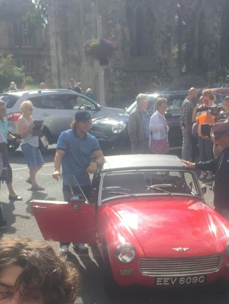 Mark Wahlberg gets into a red car in St Andrews.