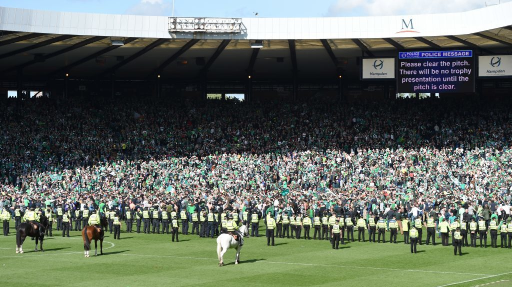 Police attempt to push back the Hibernian fans