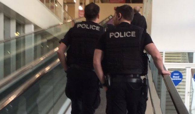 Armed police go shopping in Tesco.