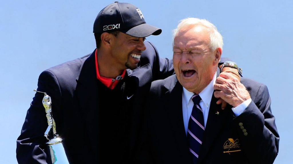 Tiger Woods and Arnold Palmer share a laugh