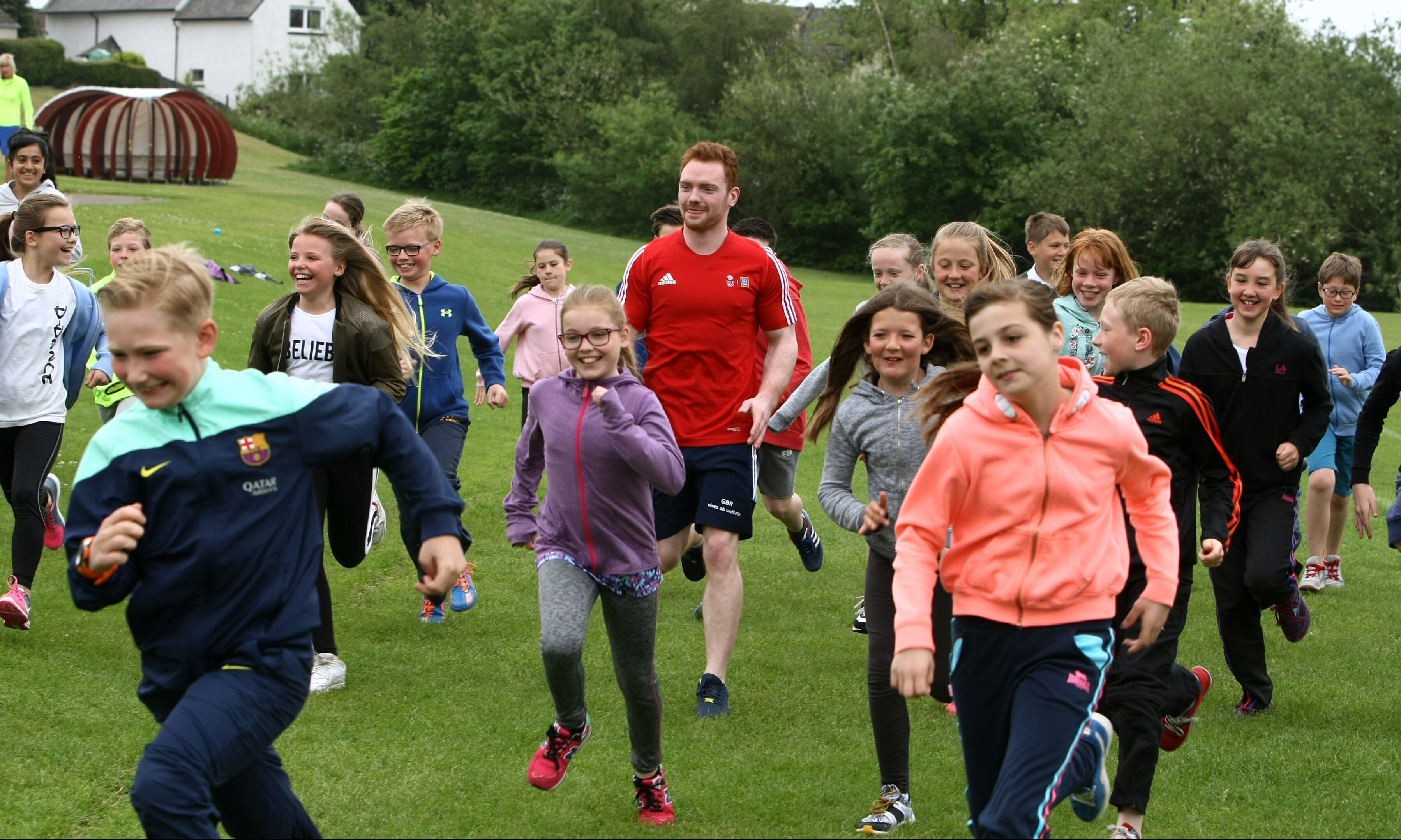 Team GB gymnast Dan Purvis taking part in the P6 daily mile at Grange Primary School in Monifieth — just one example of how schools are working to ensure pupils stay fit and active.