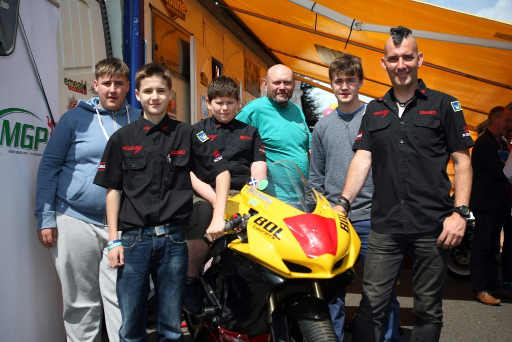 Ian Pert at some of the Hedzup youngsters at a fundraising event