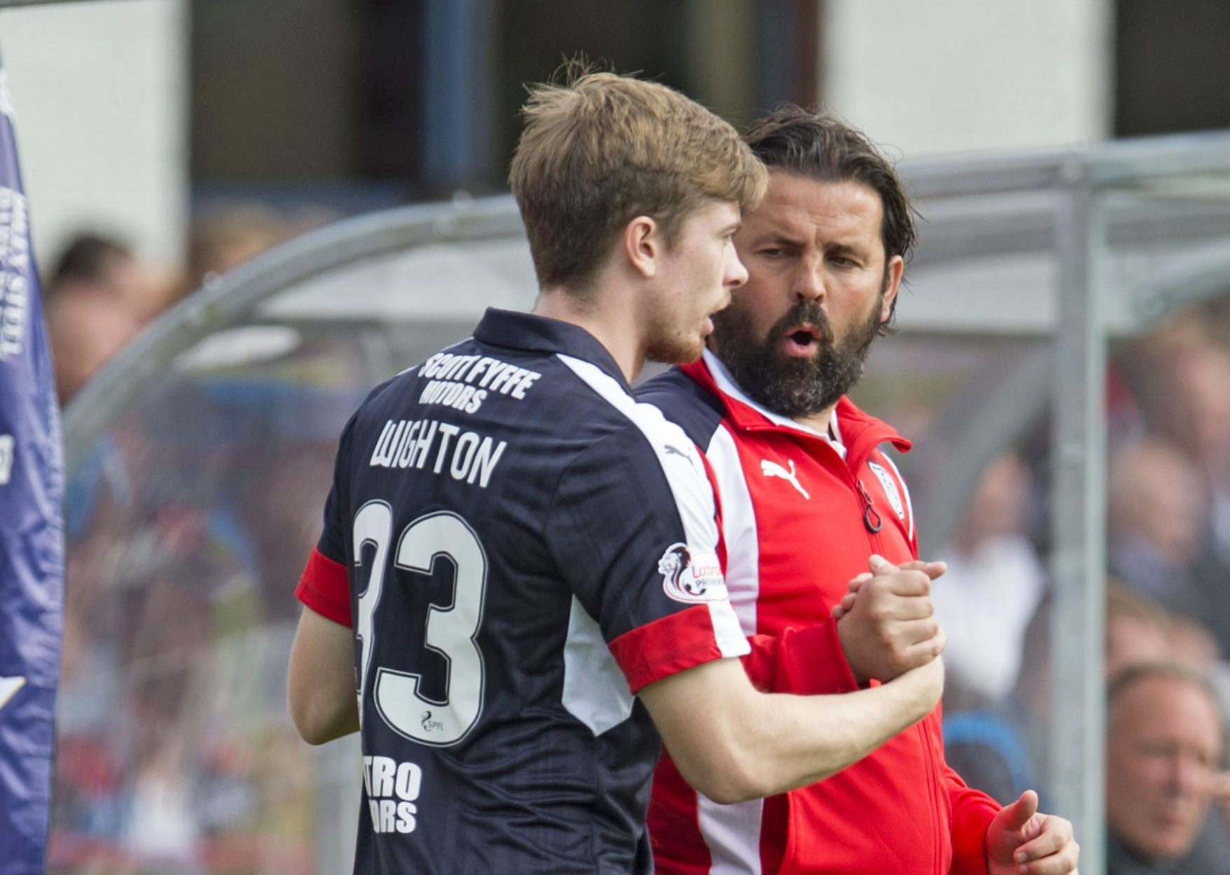 Craig Wighton with his manager Paul Hartley.