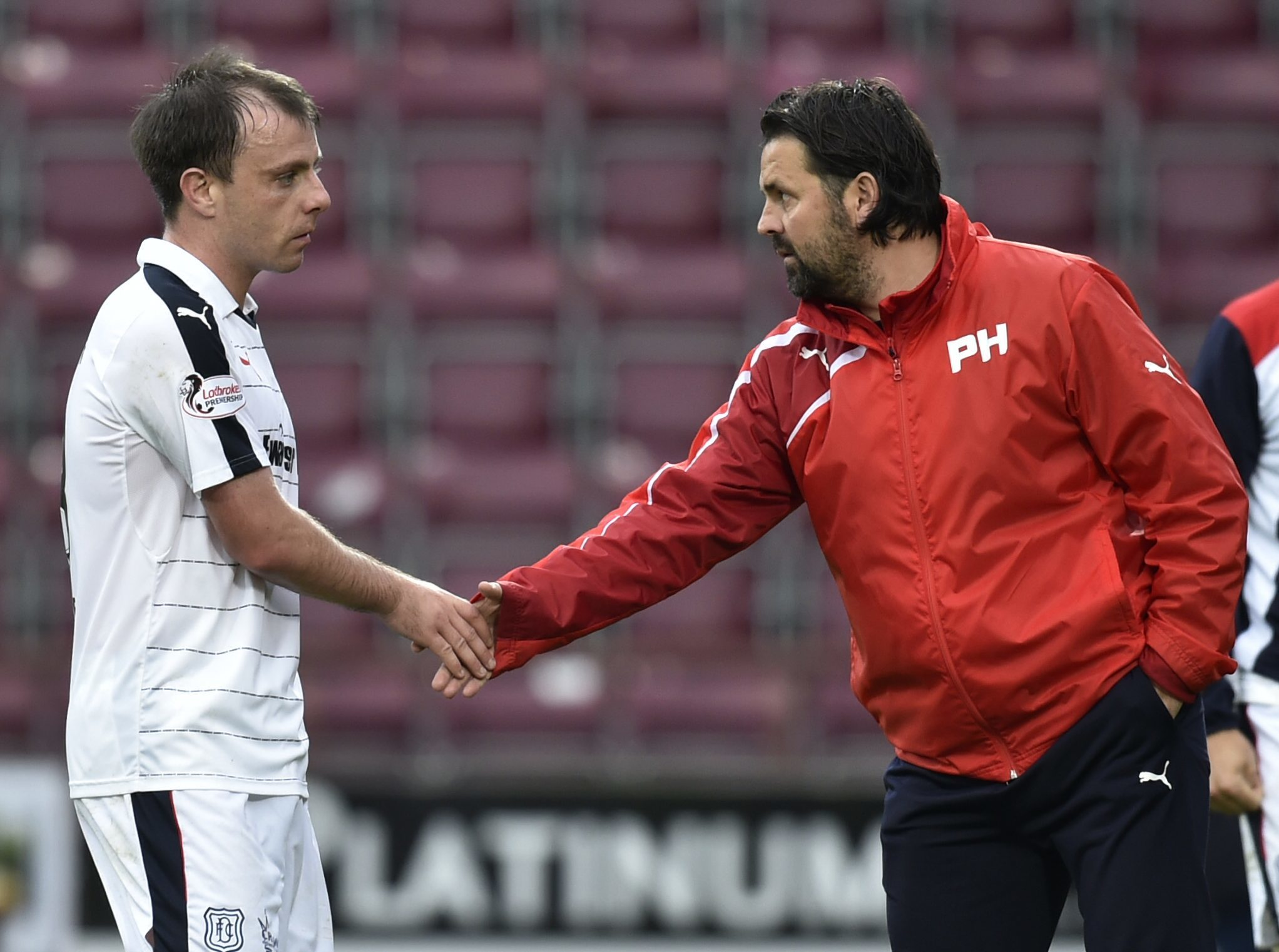 Dundee manager Paul Hartley  with Paul McGowan at full time.