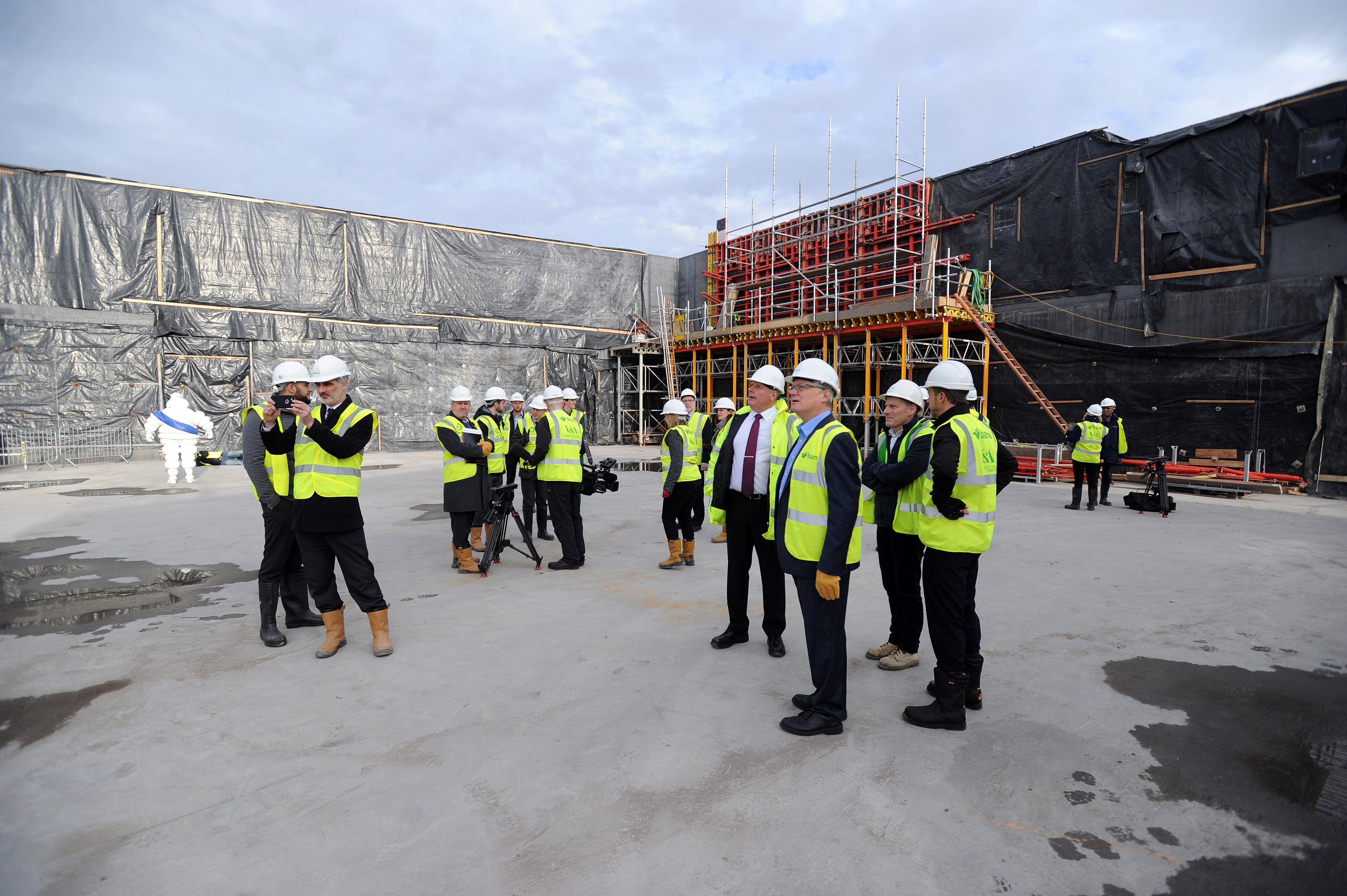 Officials and members of the press taking a tour of the recently completed Michelin Design Gallery, at the V&A Museum construction site.