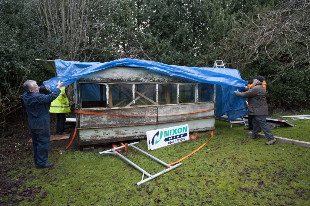 Volunteers from Dundee Transport Museum remove the last surviving horse drawn tram from the garden in Perth.