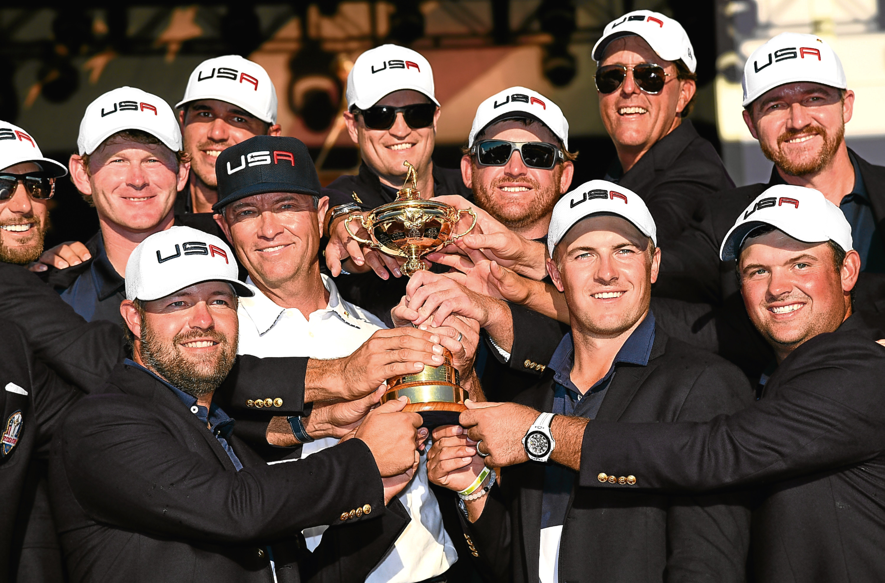 Davis Love (centre) with his victorious US team after their Ryder Cup win at Hazeltine.