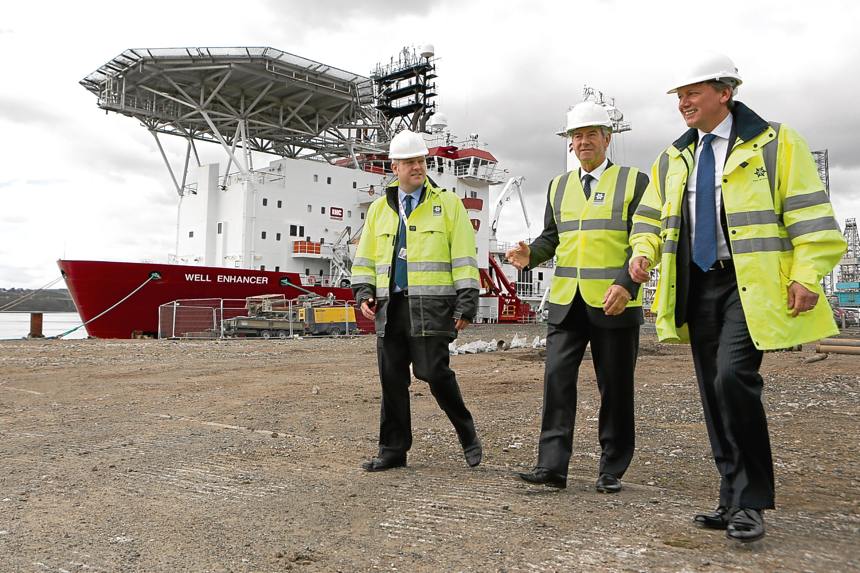 Port Manager David Webster, chairman Lord Smith of Kelvin and Forth Ports CEO Charles Hammond inspect work to upgrade Prince Charles Wharf at the Port of Dundee
