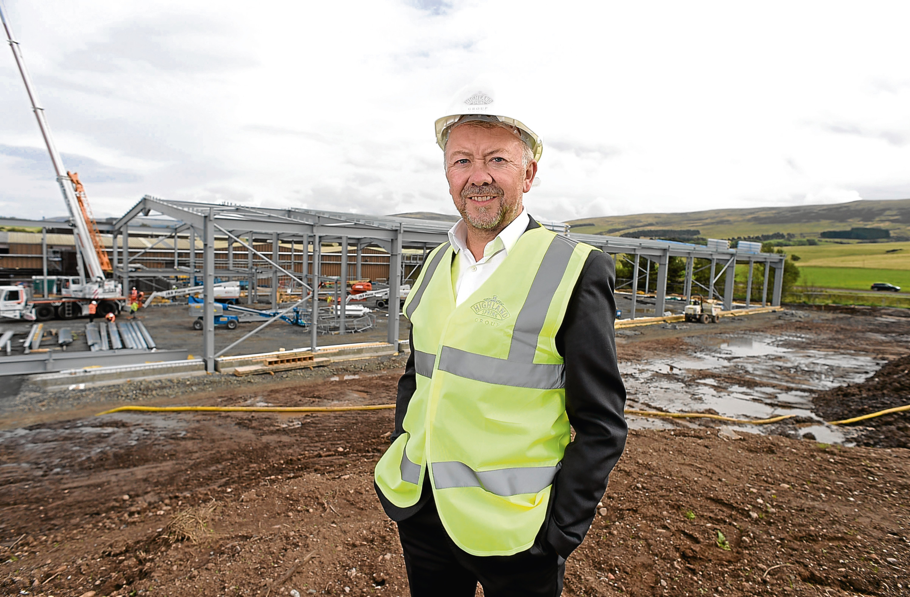 Les Montgomery, chief executive of Highland Spring Group, overseeing construction work on a new bottling facility at its Blackford.